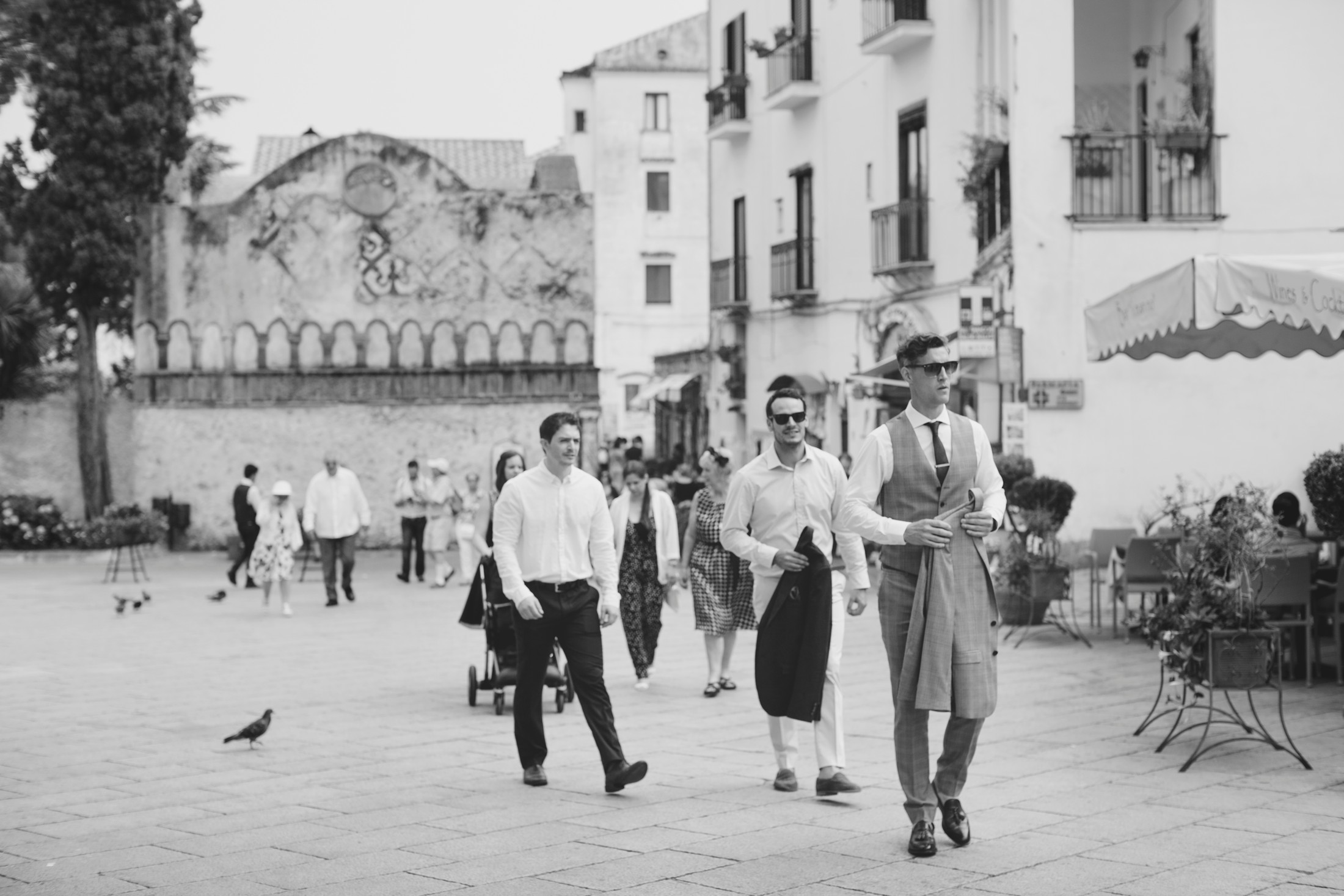 groom with his best men walking to the ravello's main square