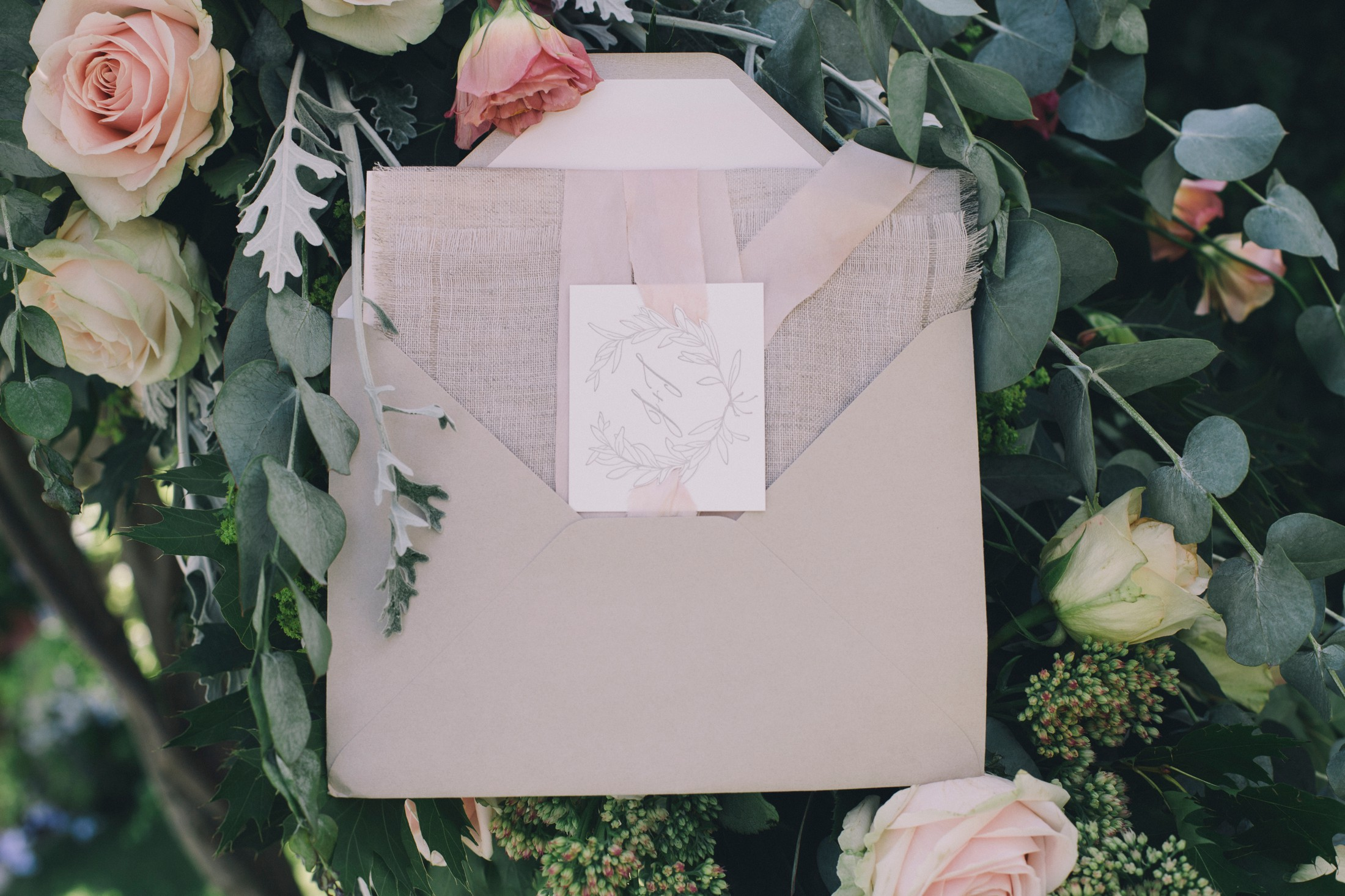 wedding invitation card in some flowers