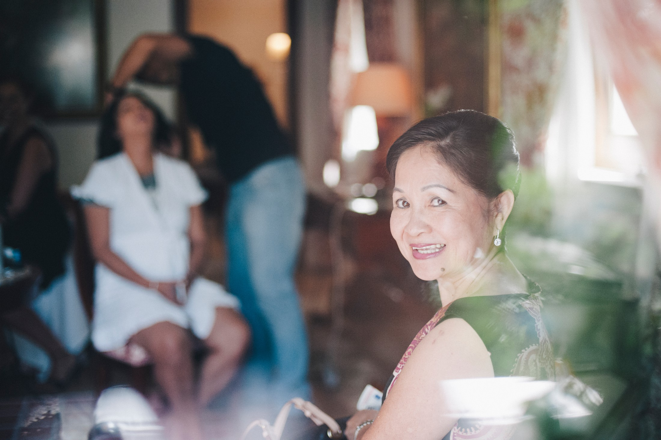 bride's mother behind the window during the preparation