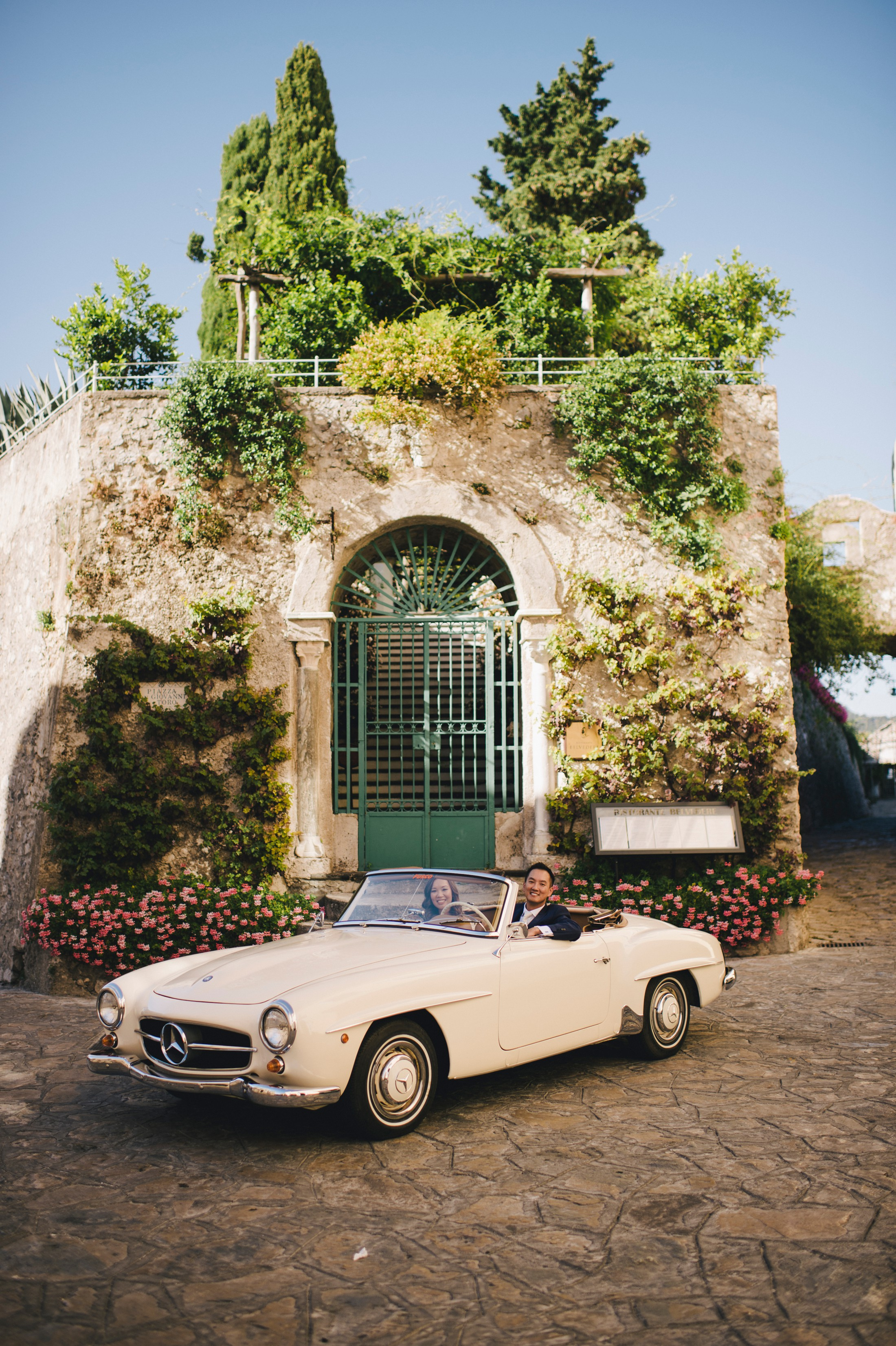 the bride and the groom in their wedding car