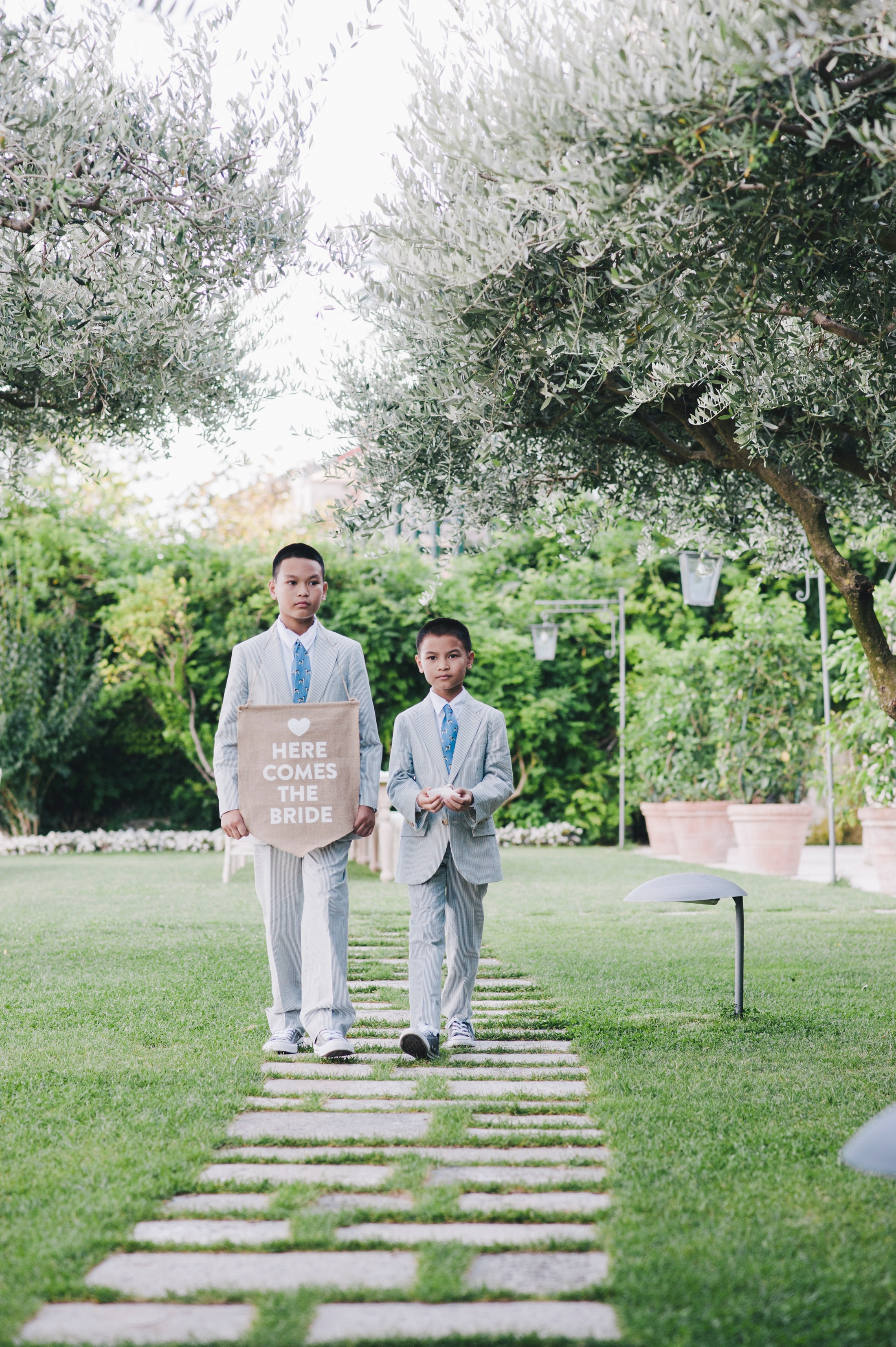 "children with ""here comes the bride"" sign"