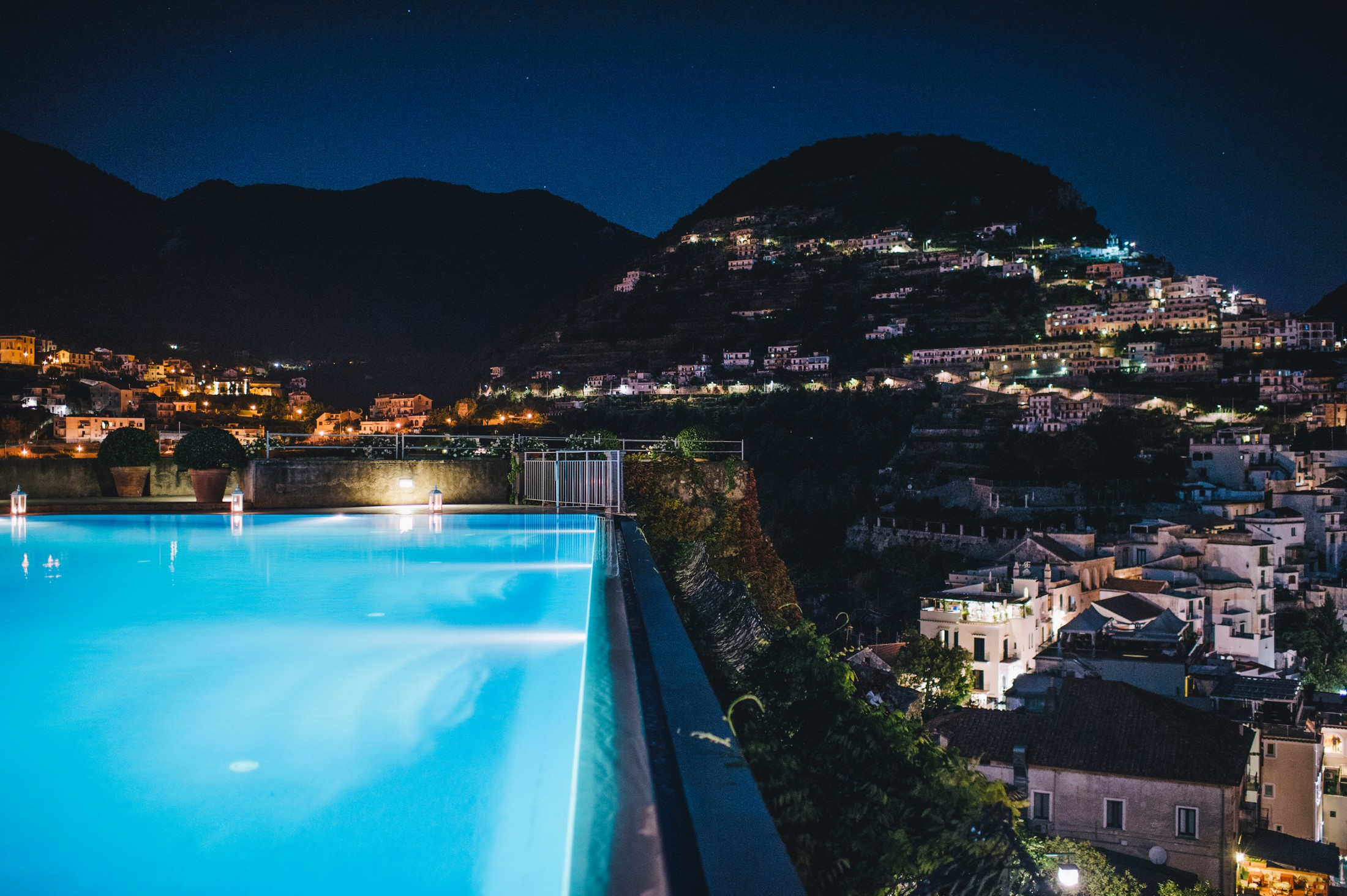 the caruso infinity pool by night
