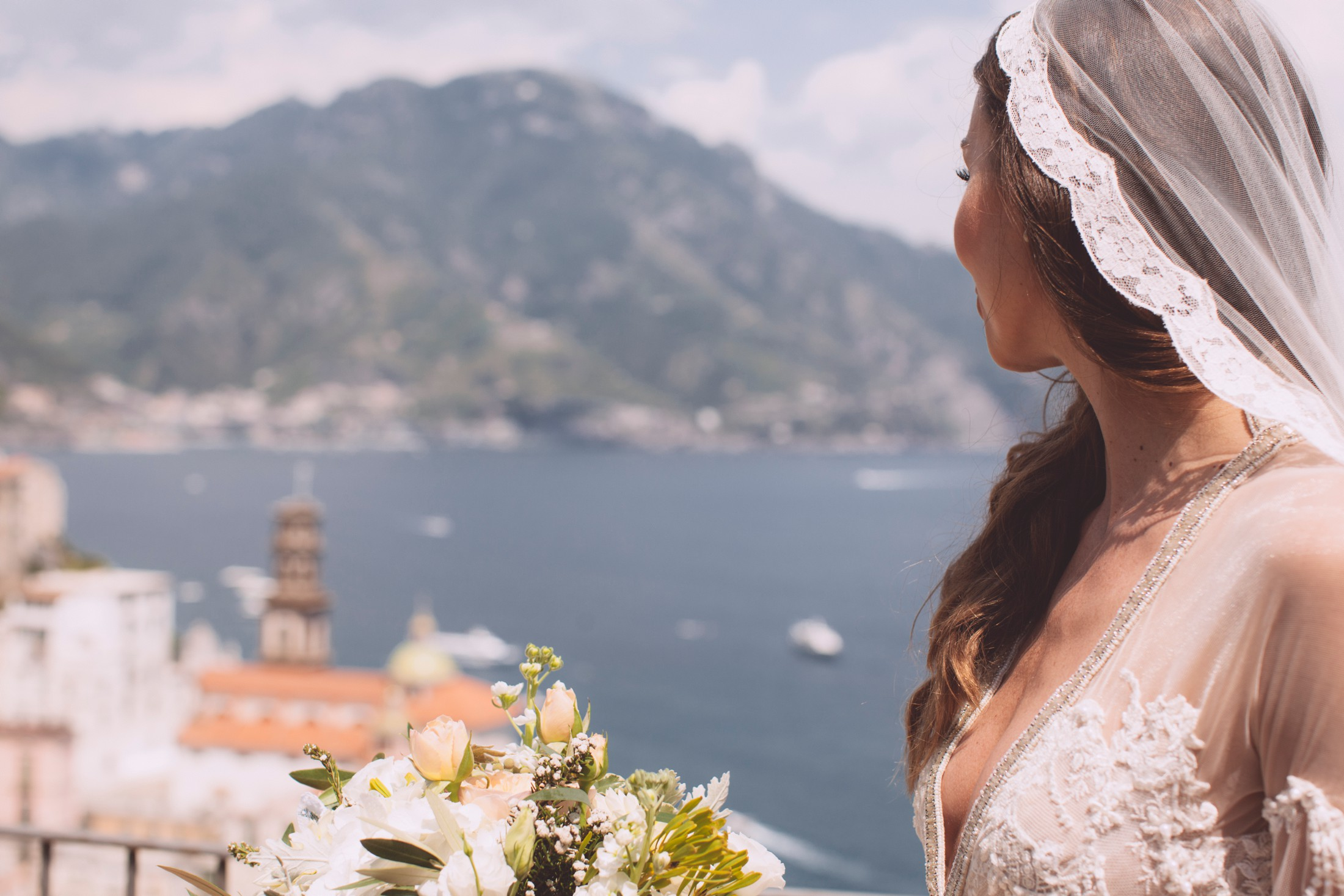 bride's portrait with atrani on the background