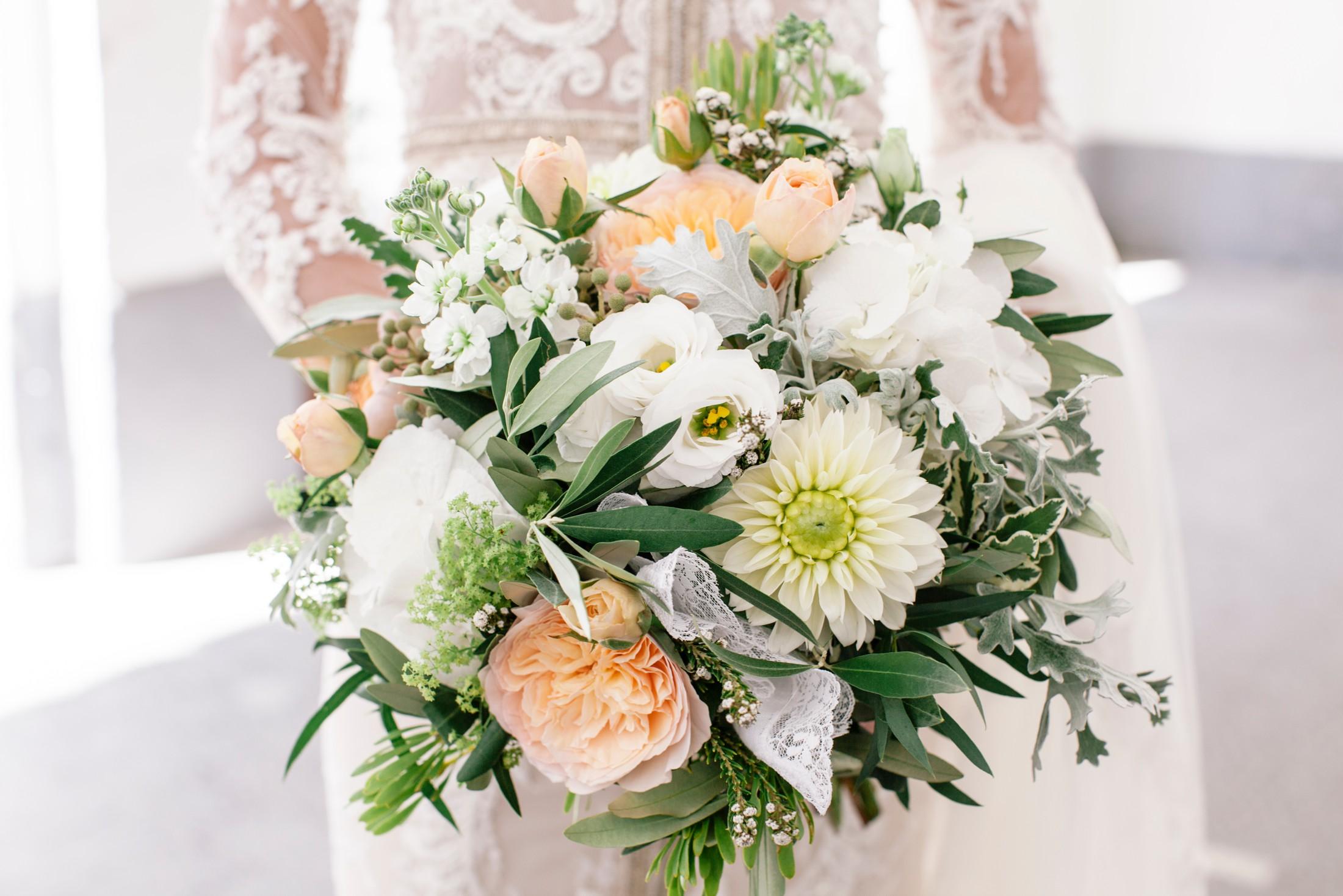 wedding brida bouquet in white and light orange