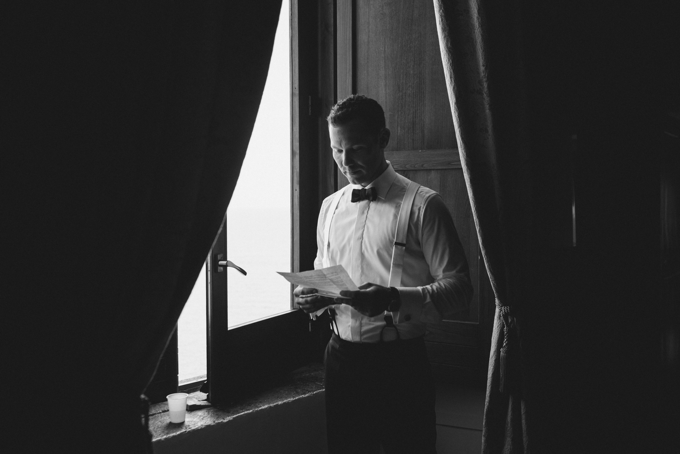 the groom reads his speech before leaving the room for the ceremony