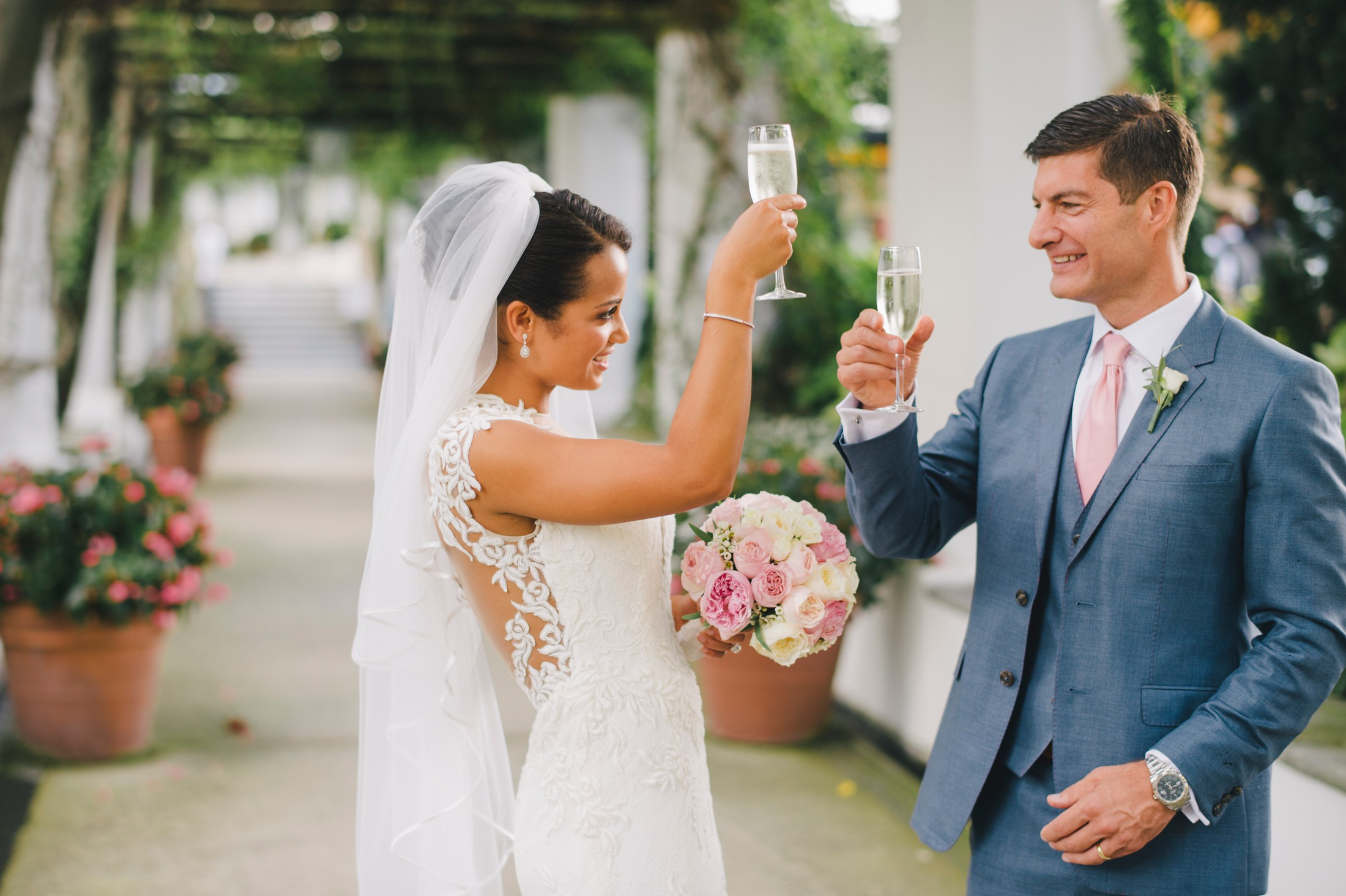 bride and groom having toast at hotel caruso