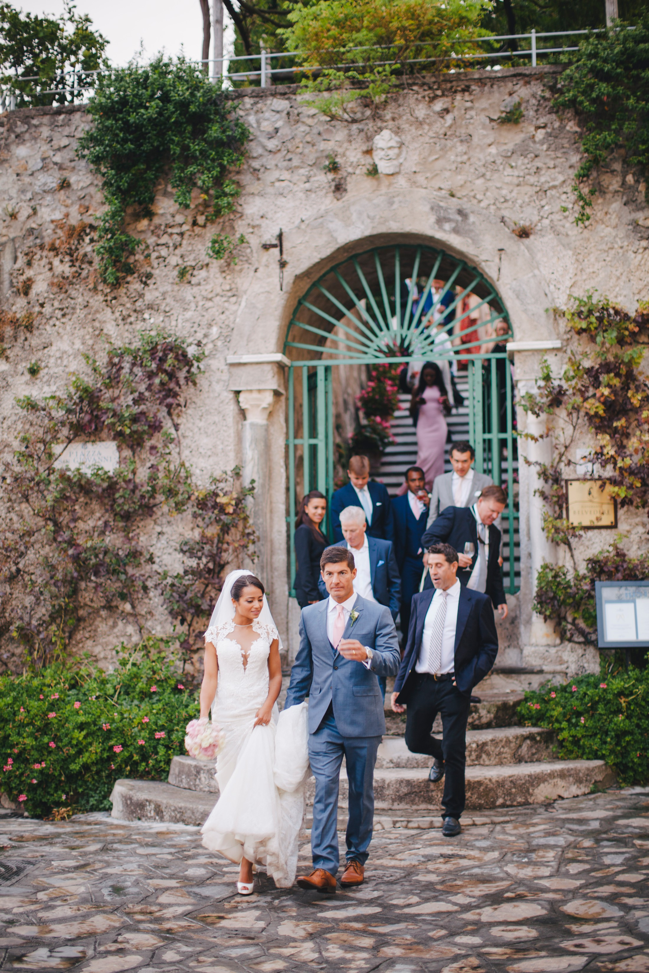 bride and groom followed by their wedding guests