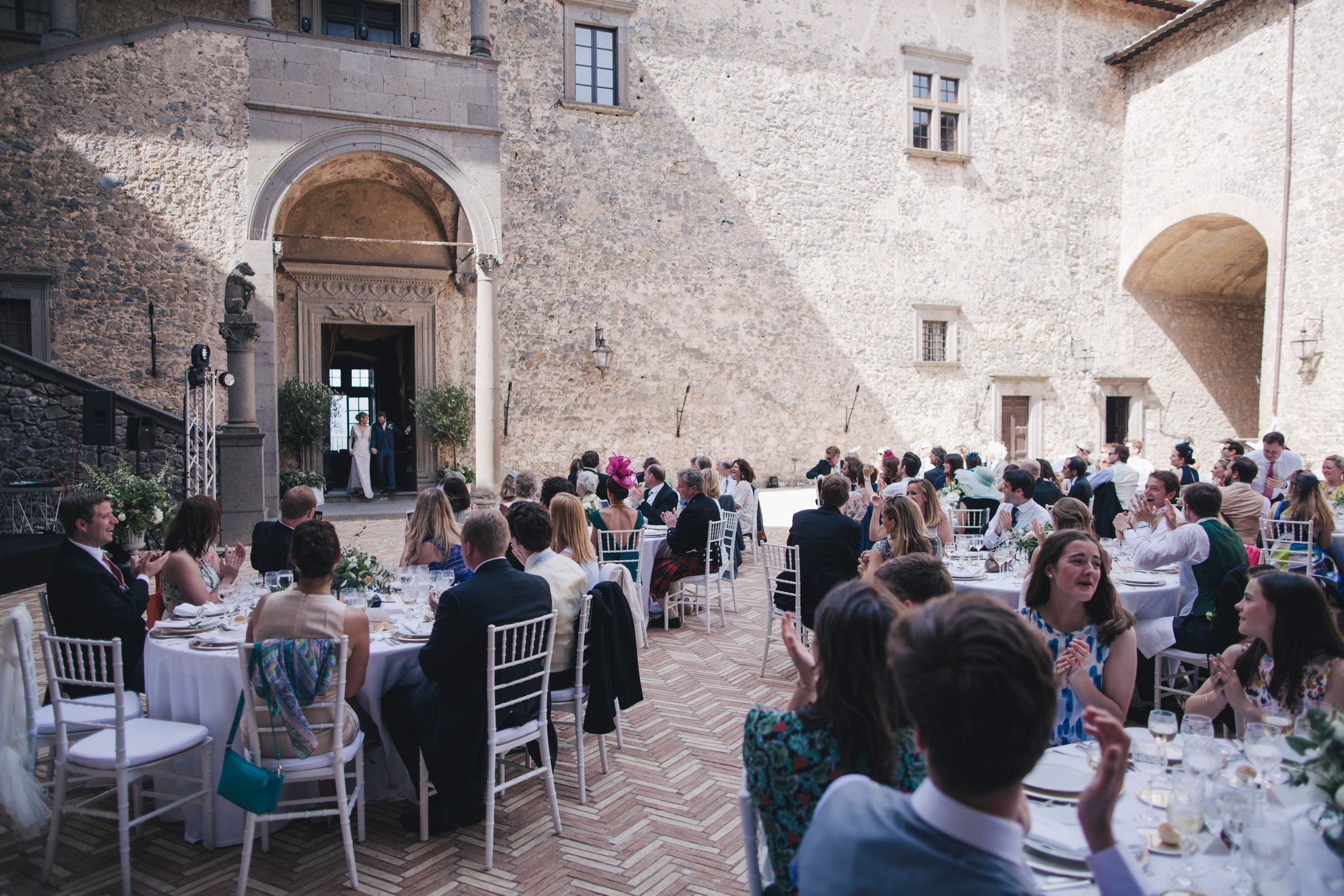 bride and groom joining the guests for the wedding dinner bracciano castle