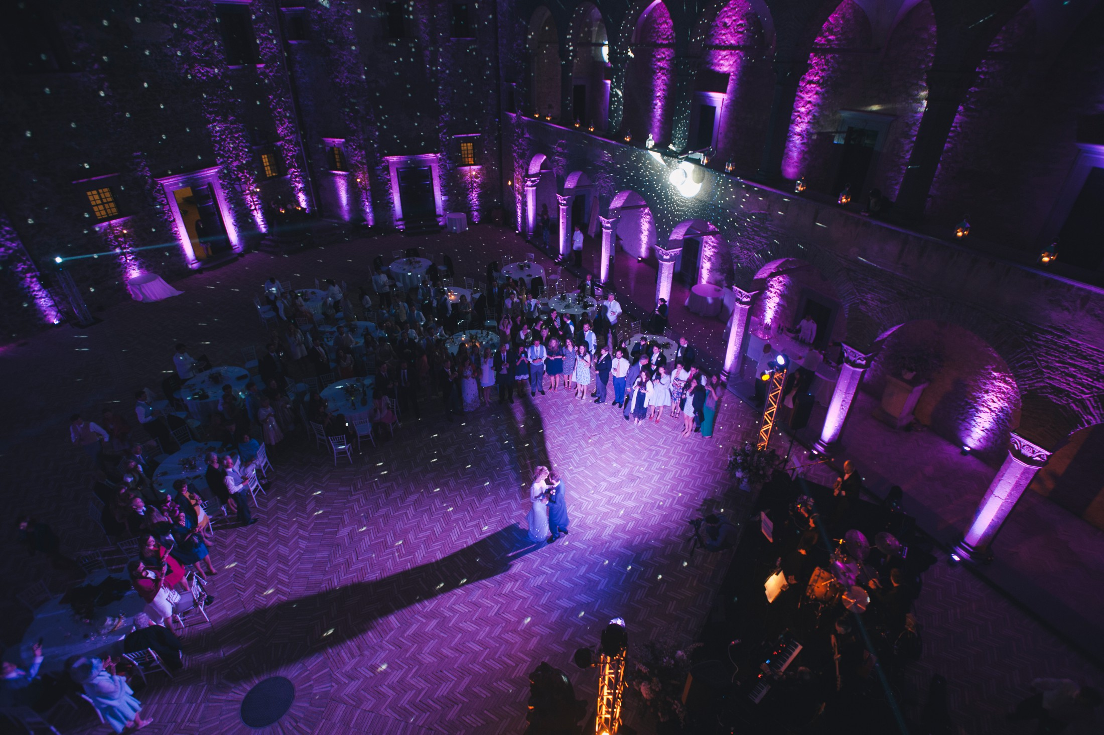 bride and groom during their first dance with all the guests