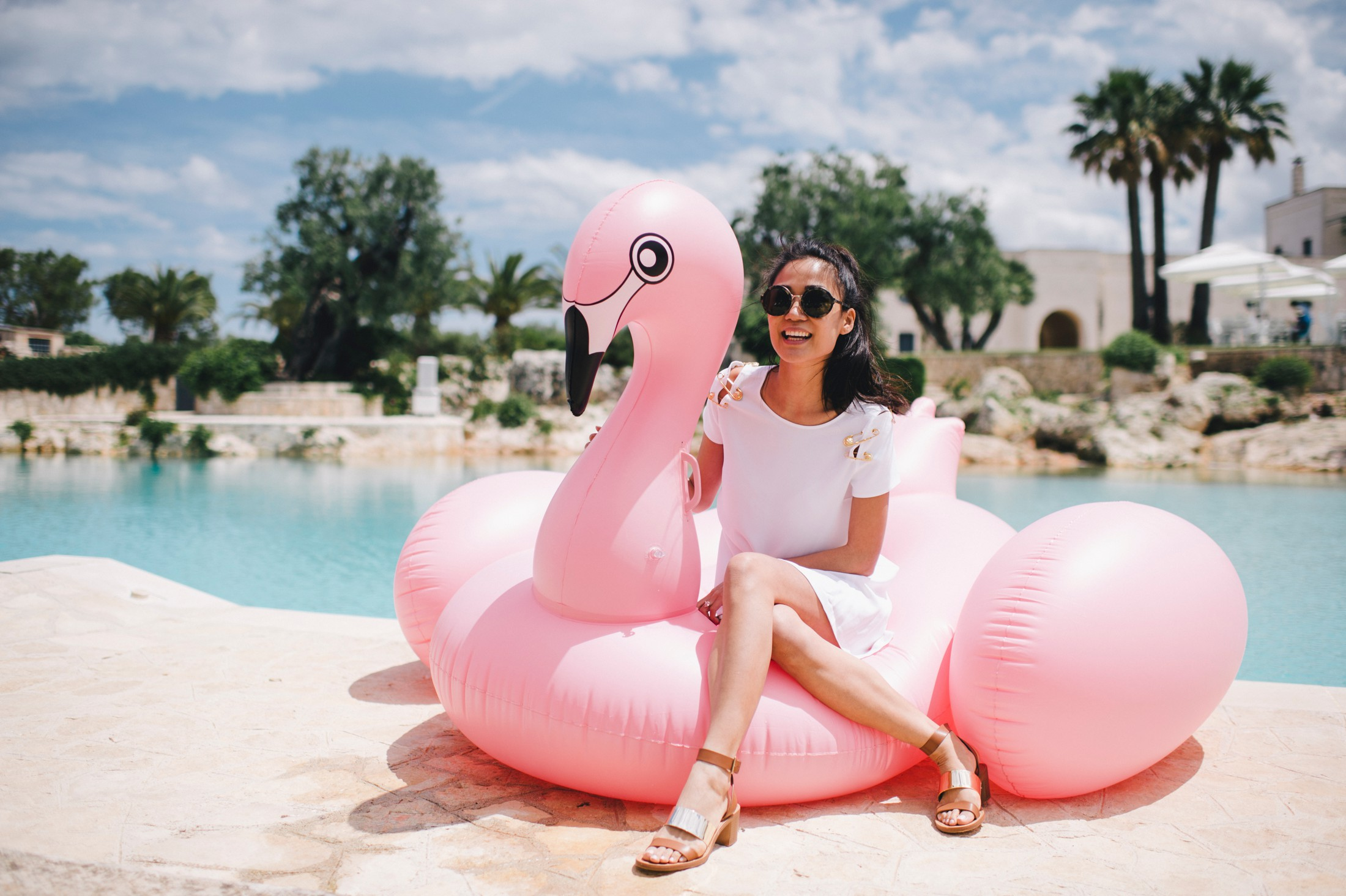 the bride sitting on a pink swan
