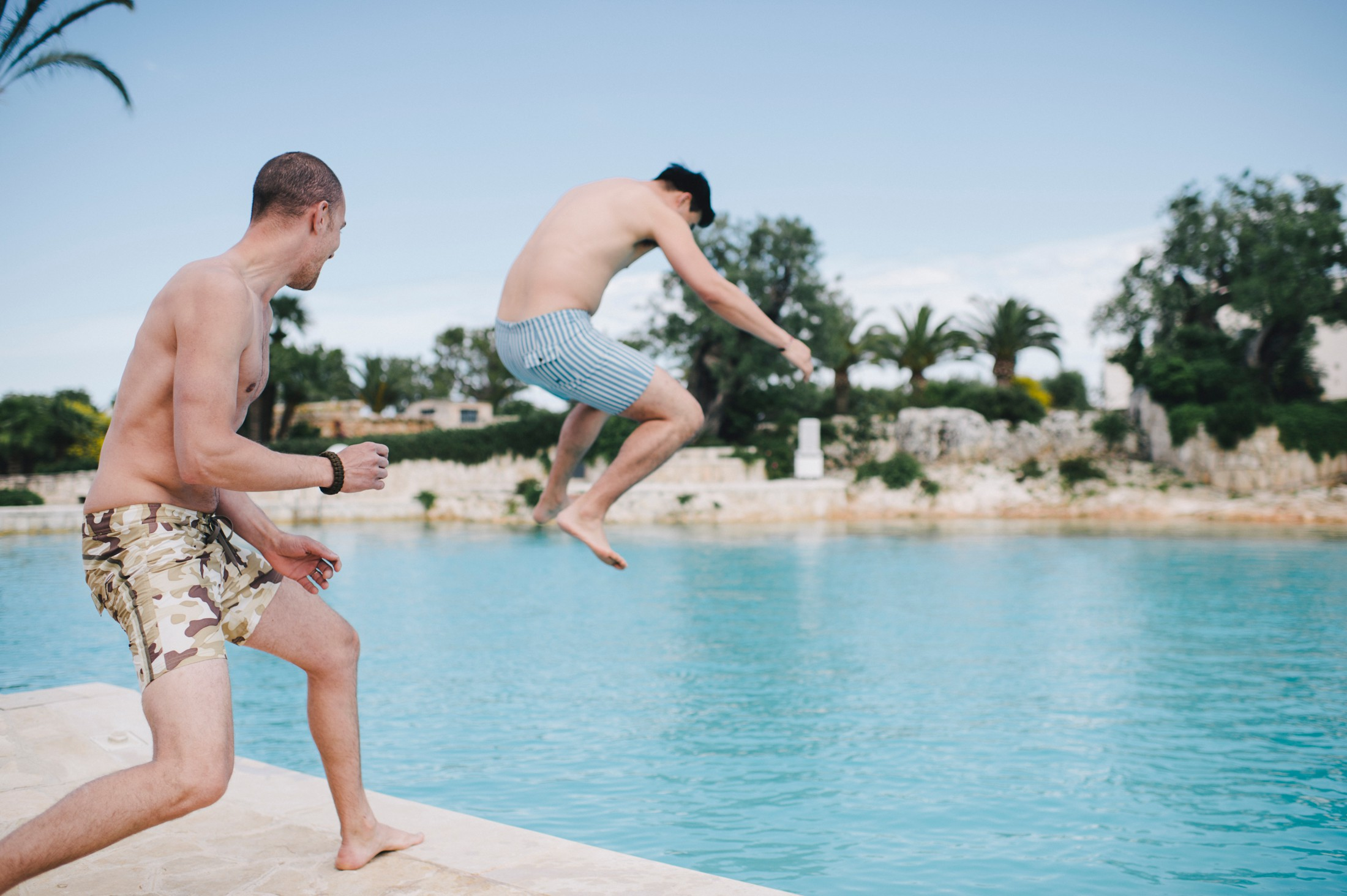 wedding guests jumping into the water