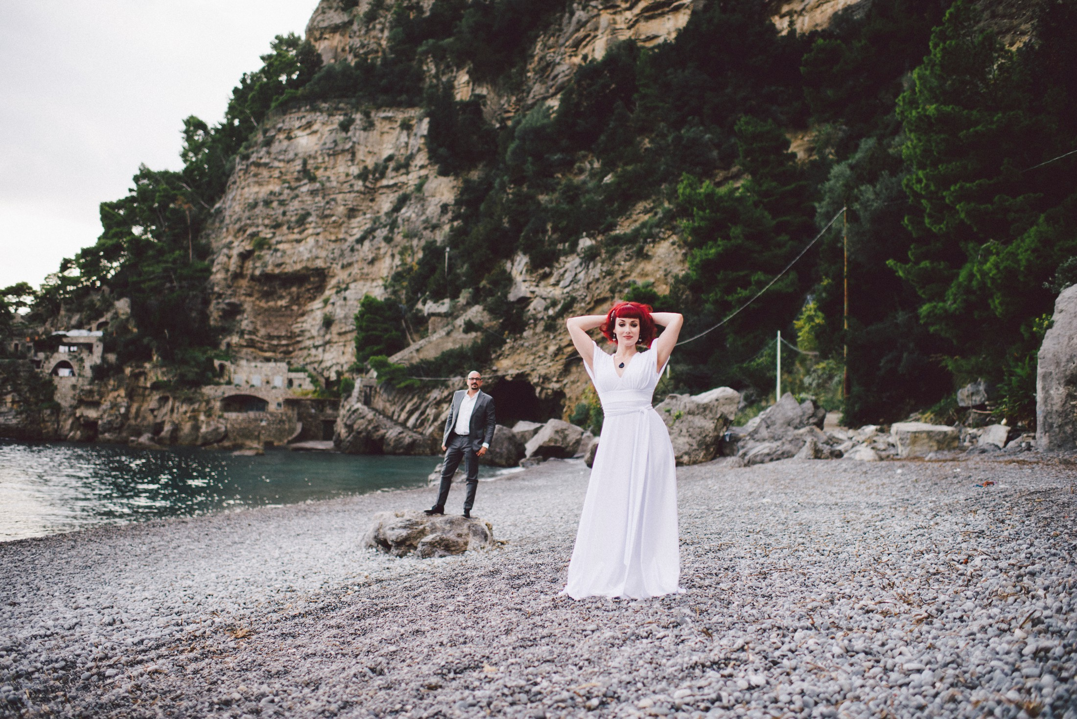 bride and groom's portrait on the beach of positano