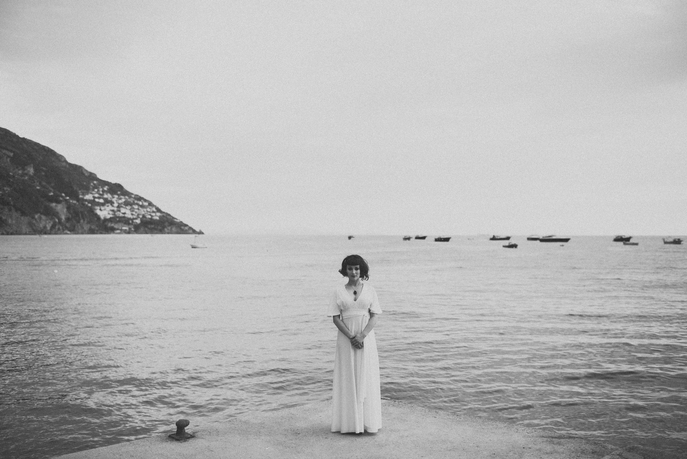 black and white bride's portrait by the sea