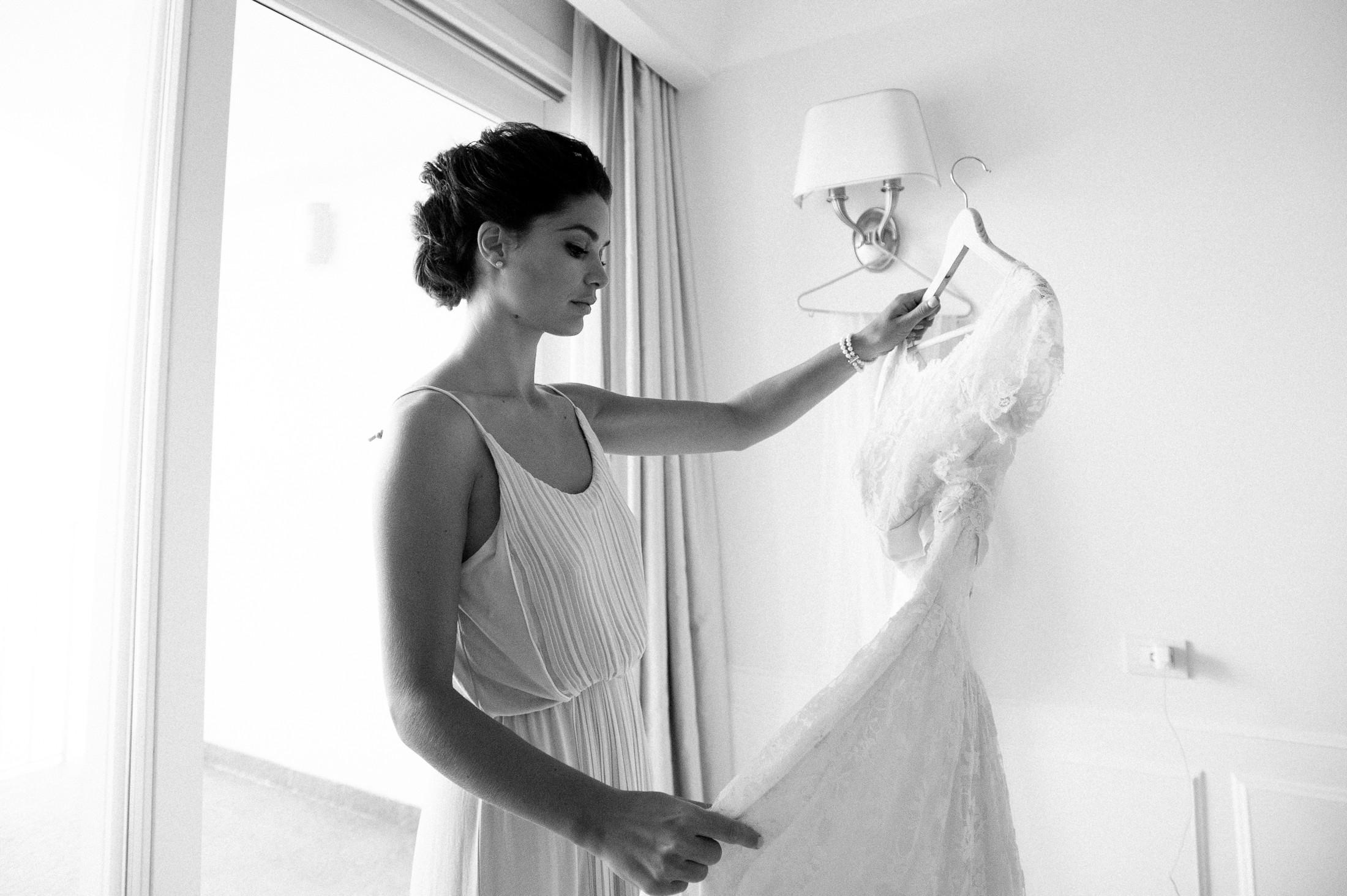 bride's hold her wedding dress