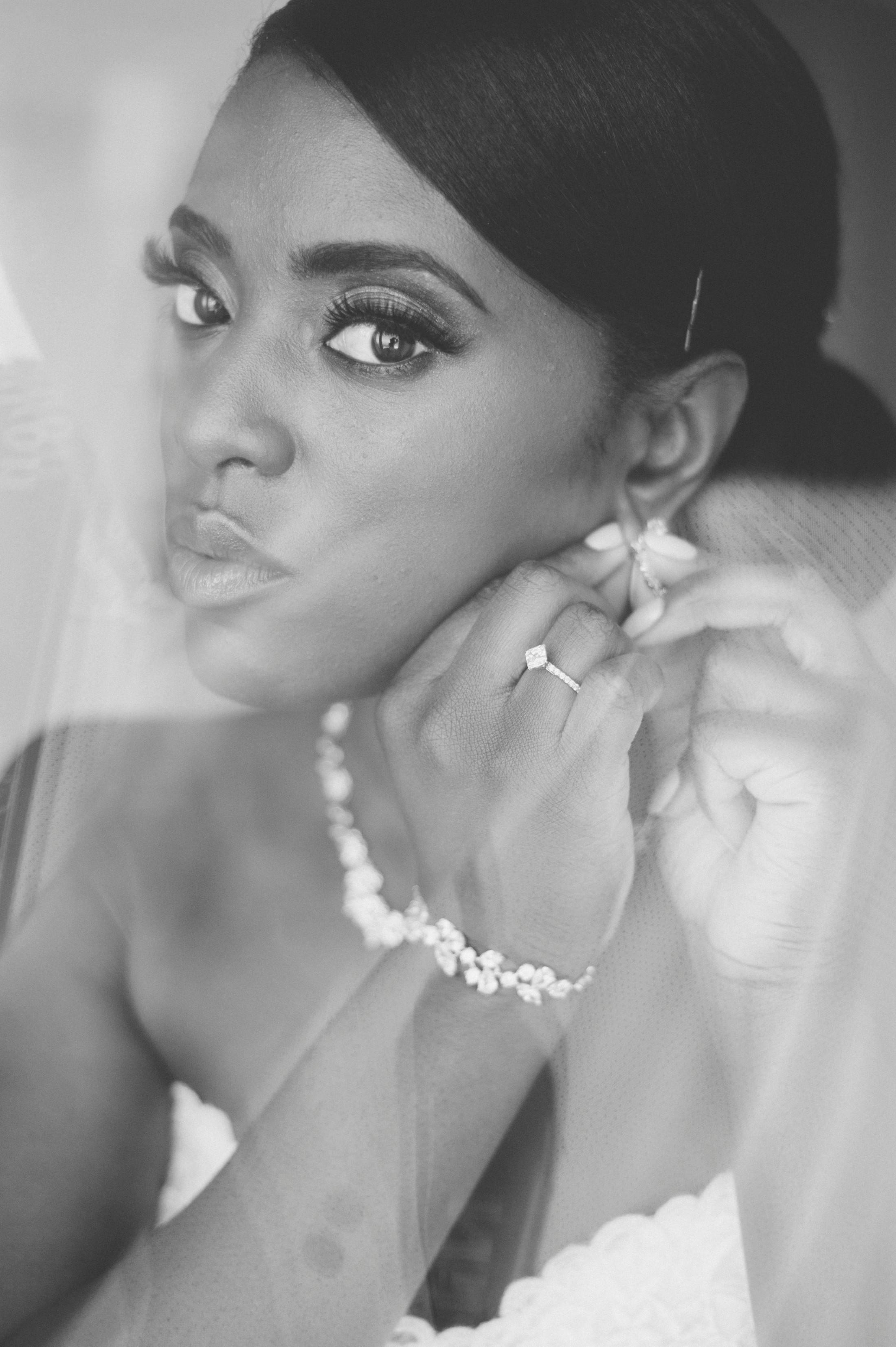 the bride wearing her earrings