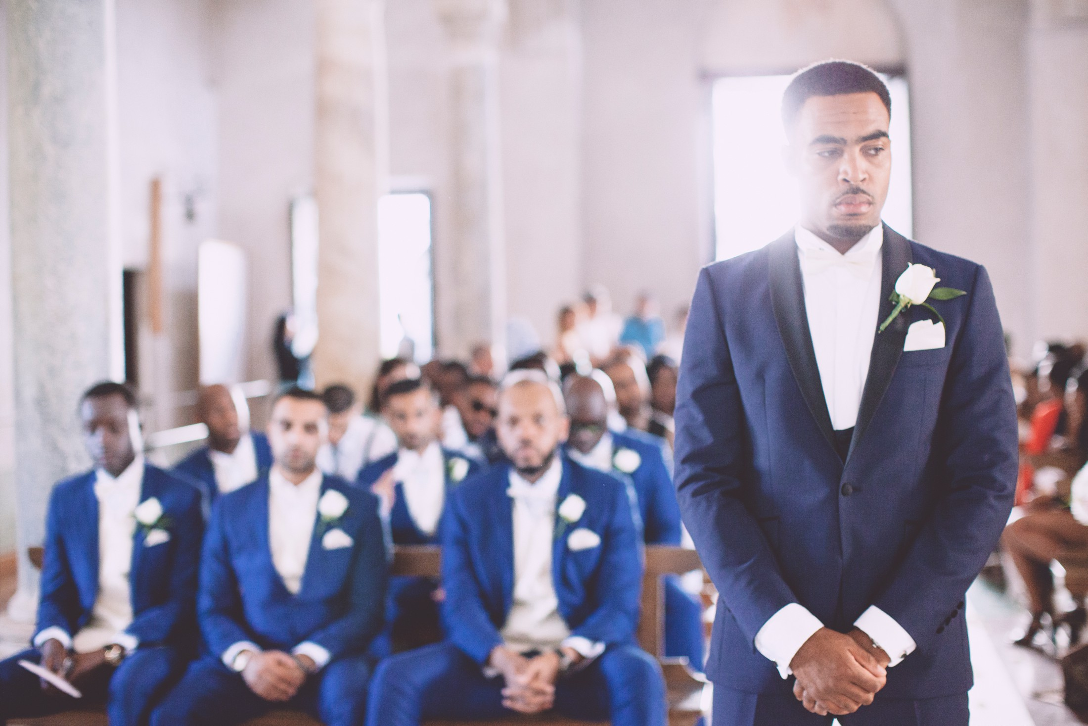 the groom waits for the bride inside the church