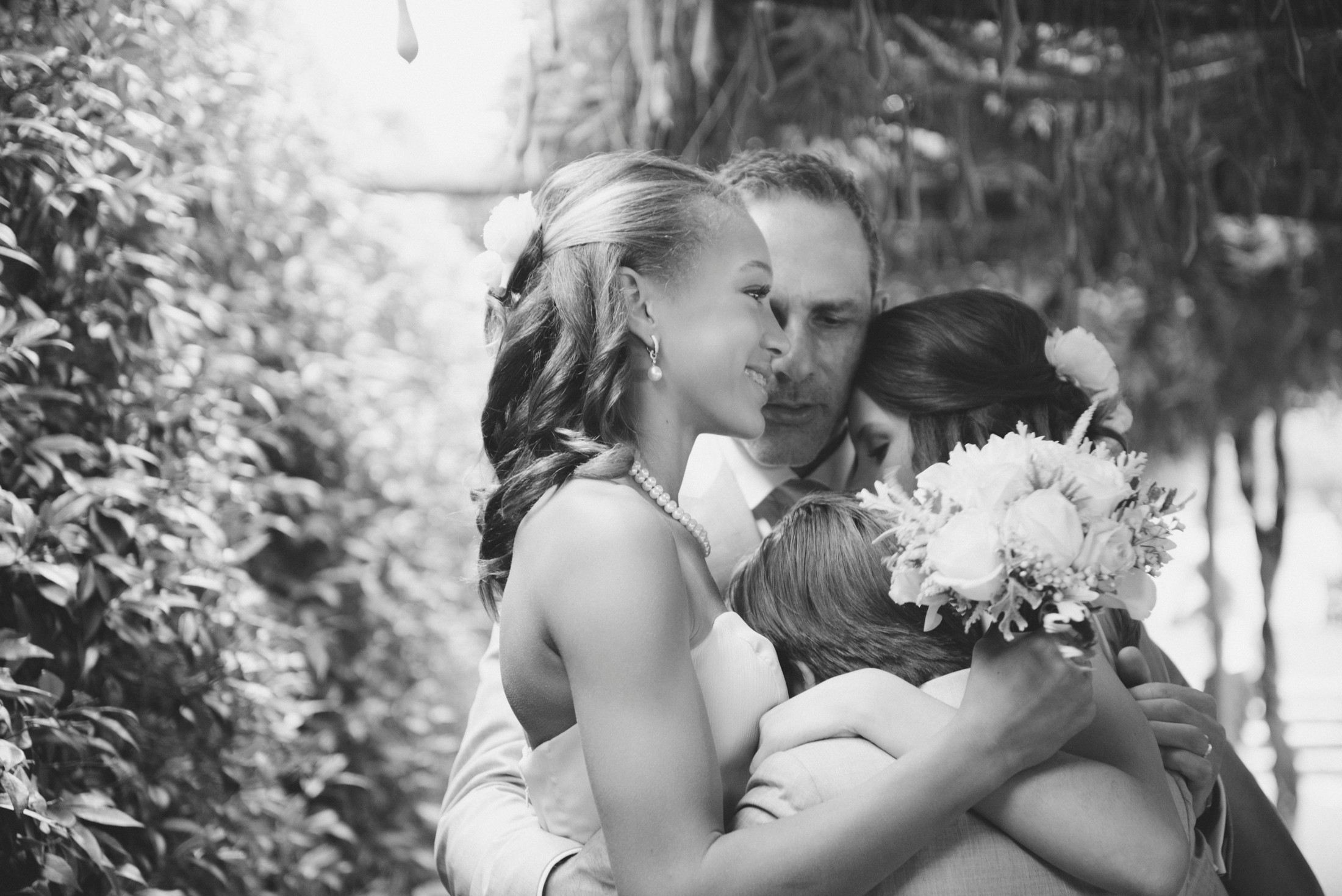 the groom with his children black and white
