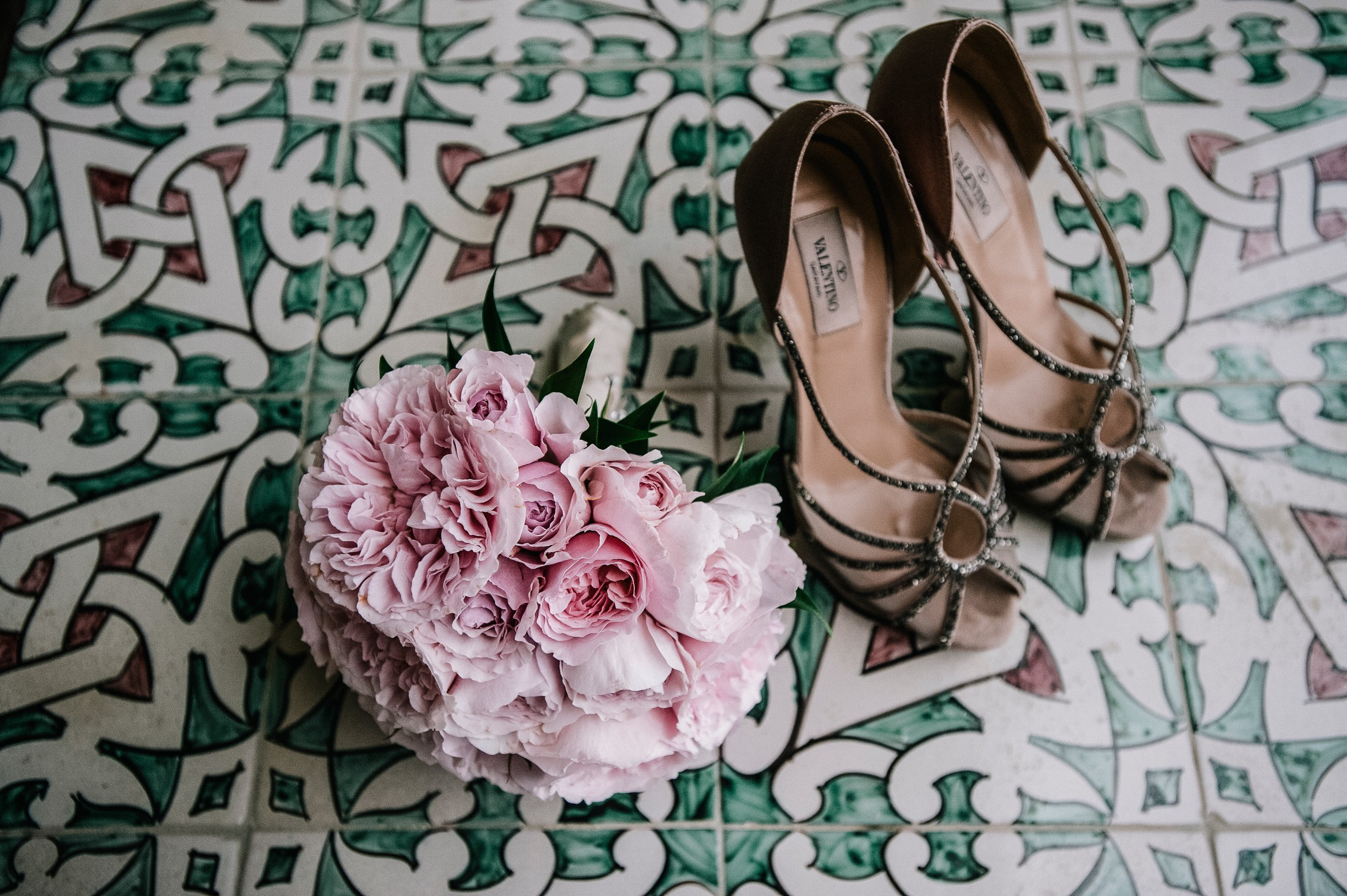 pink wedding bouquet with wedding shoes