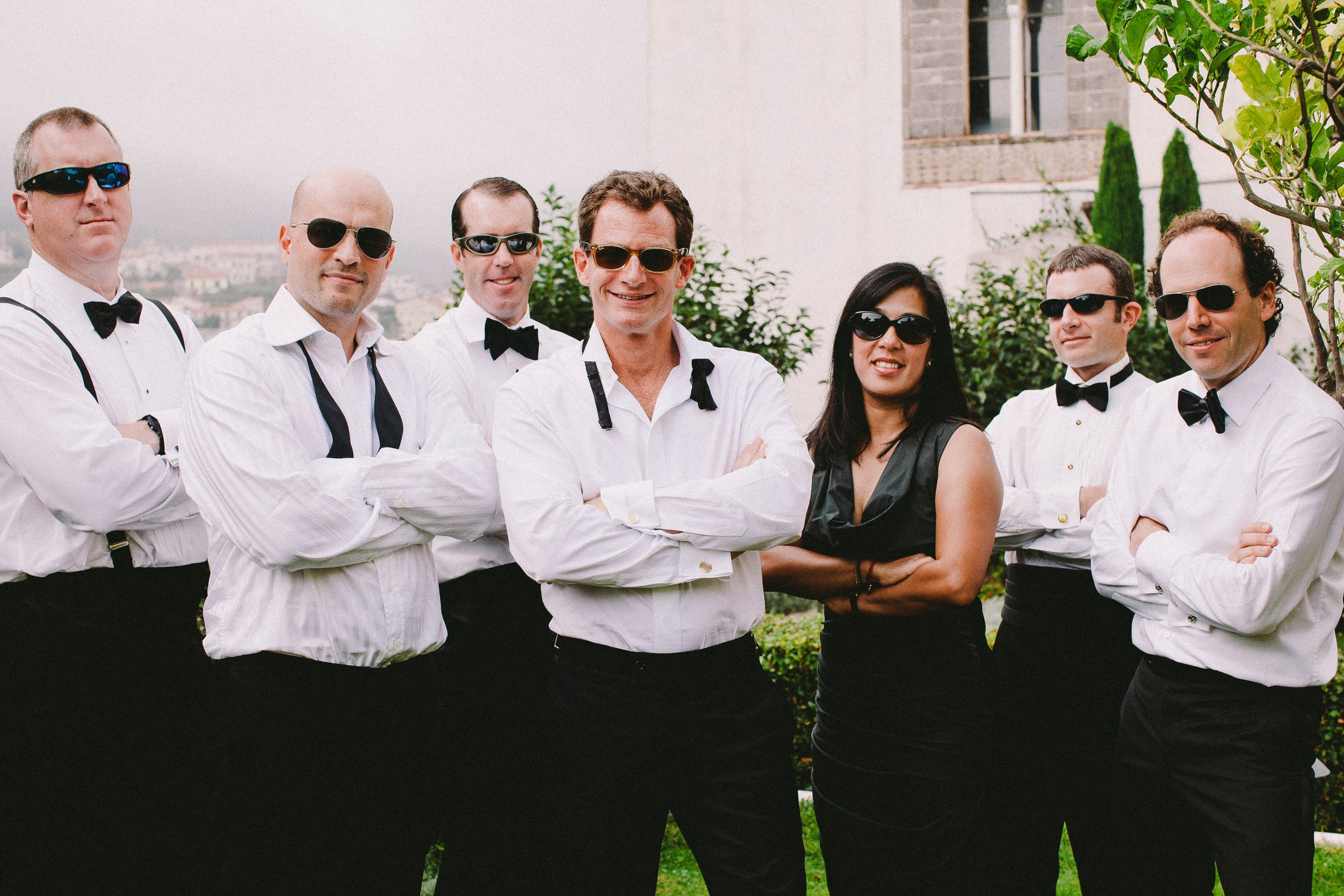 the groom with his best men with sunglasses