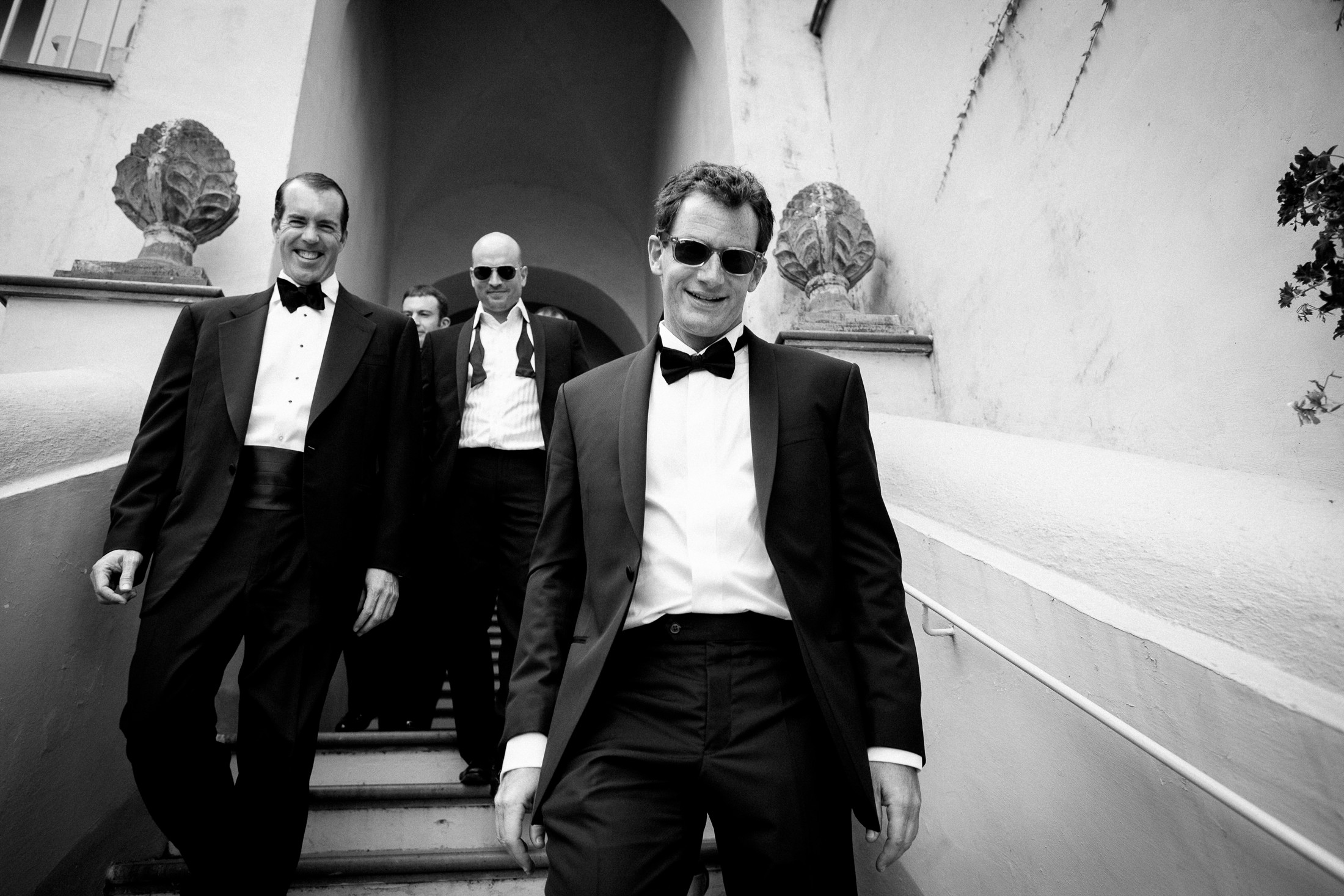 the groom and the best men in black and white