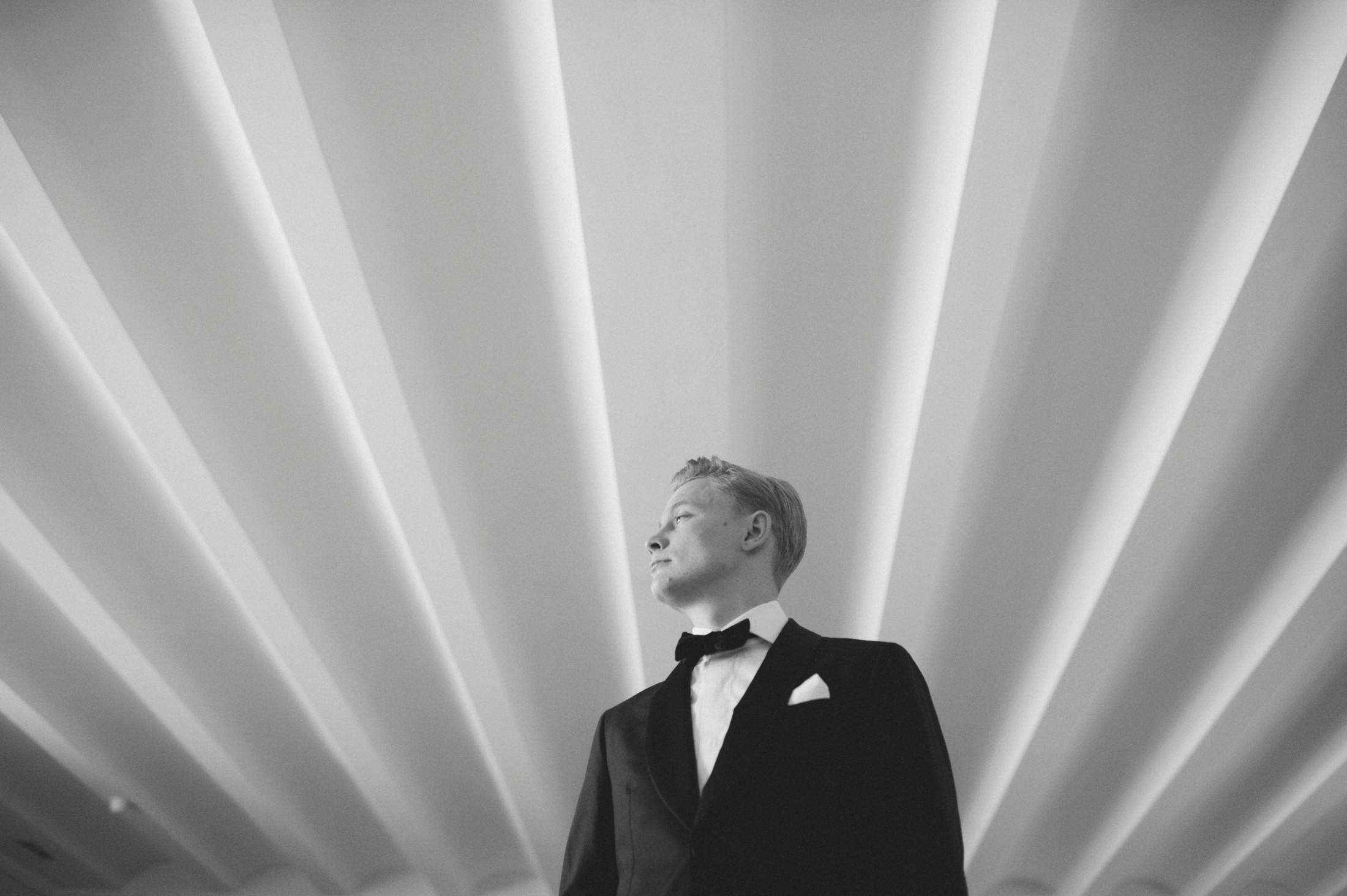 black and white groom's portrait