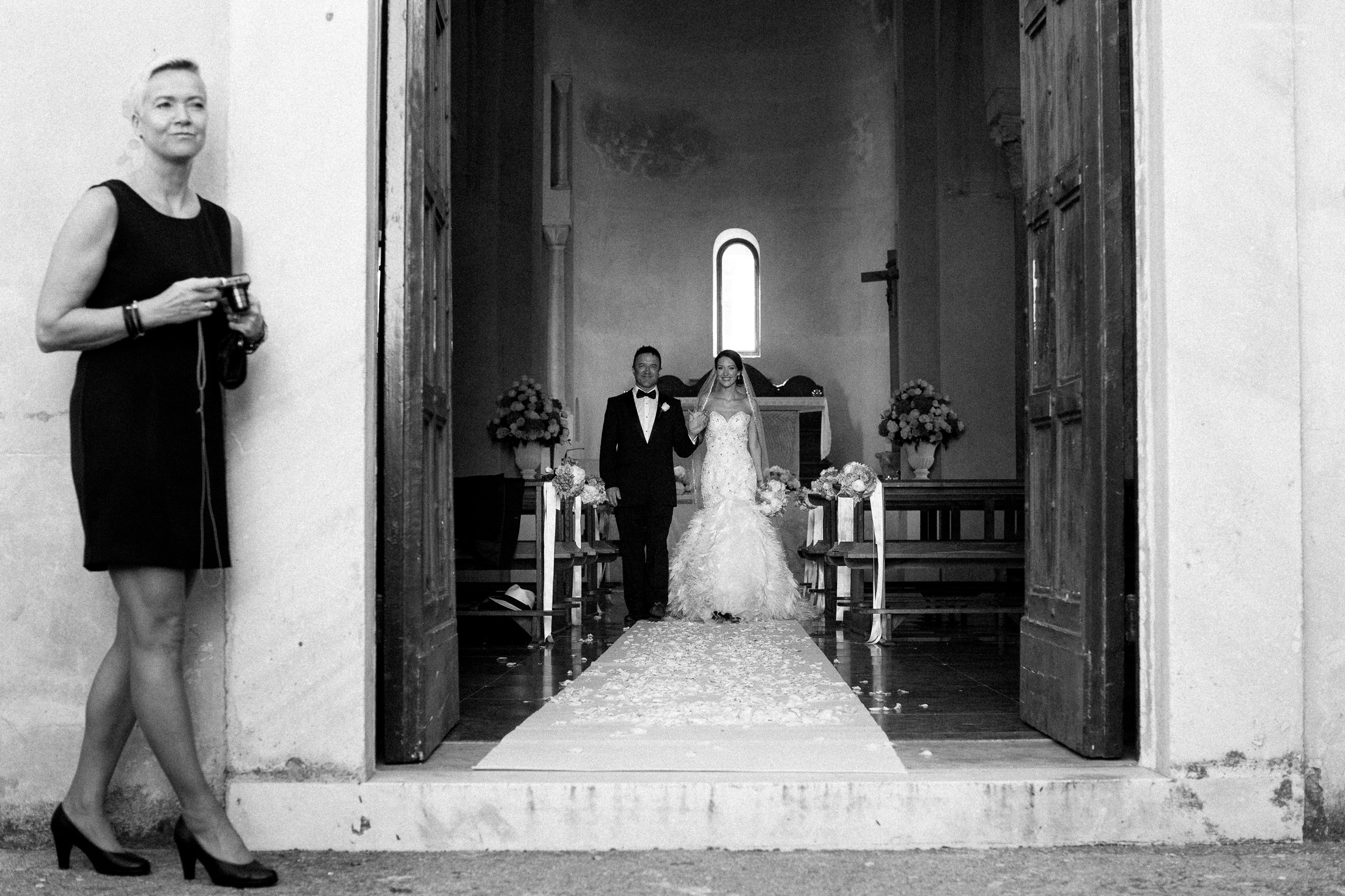 the bride and the groom leaving the church