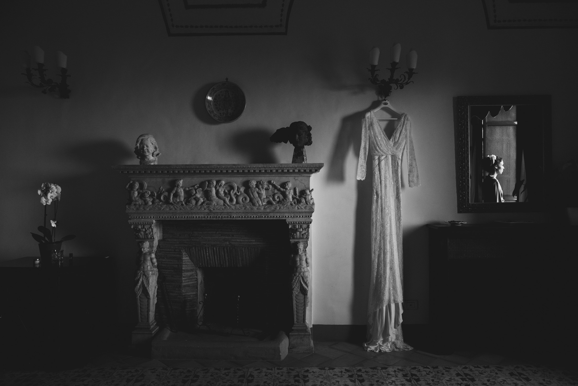 wedding dress and the bride standing at the window black and white wedding at villa cimbrone