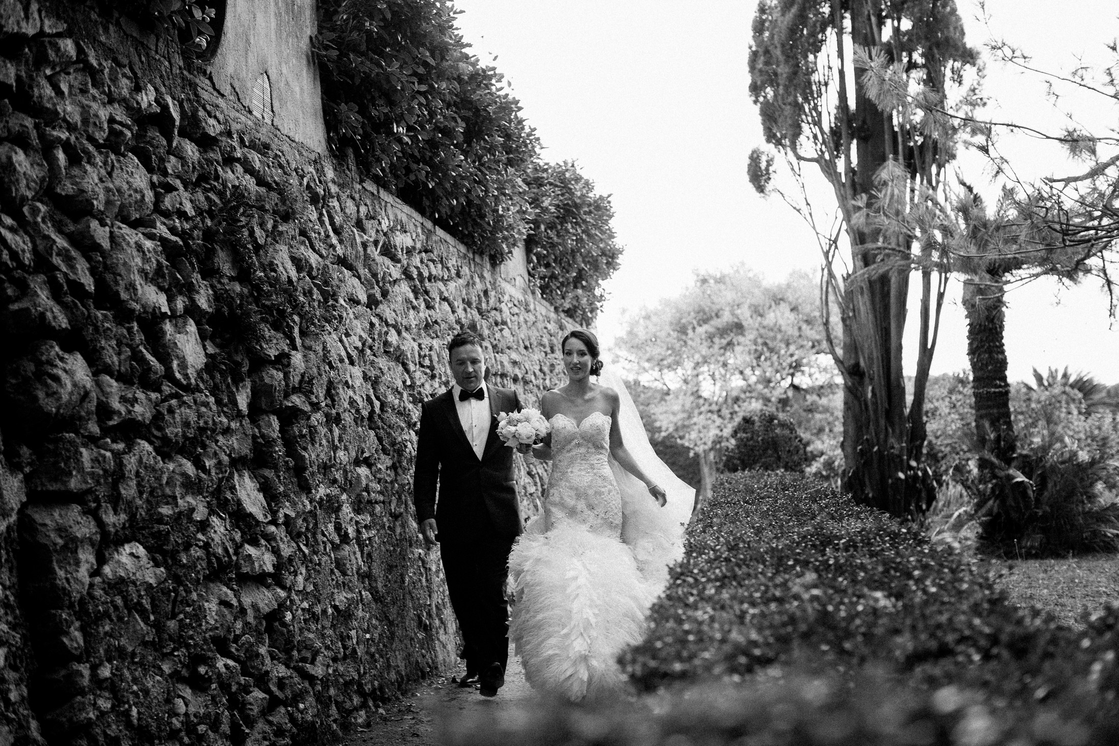 the bride walking with her groom