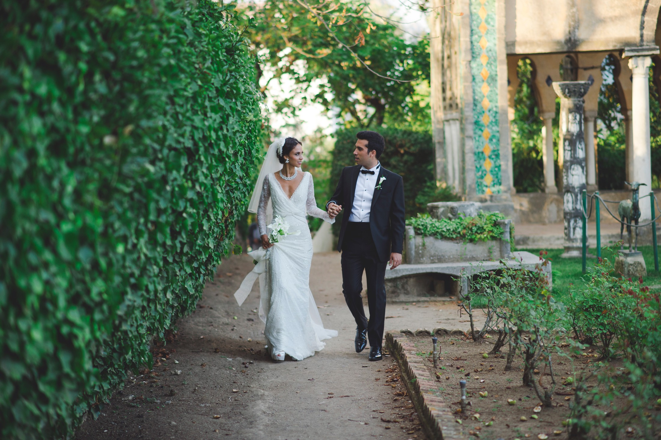 the bride walks with her brother to the ceremony