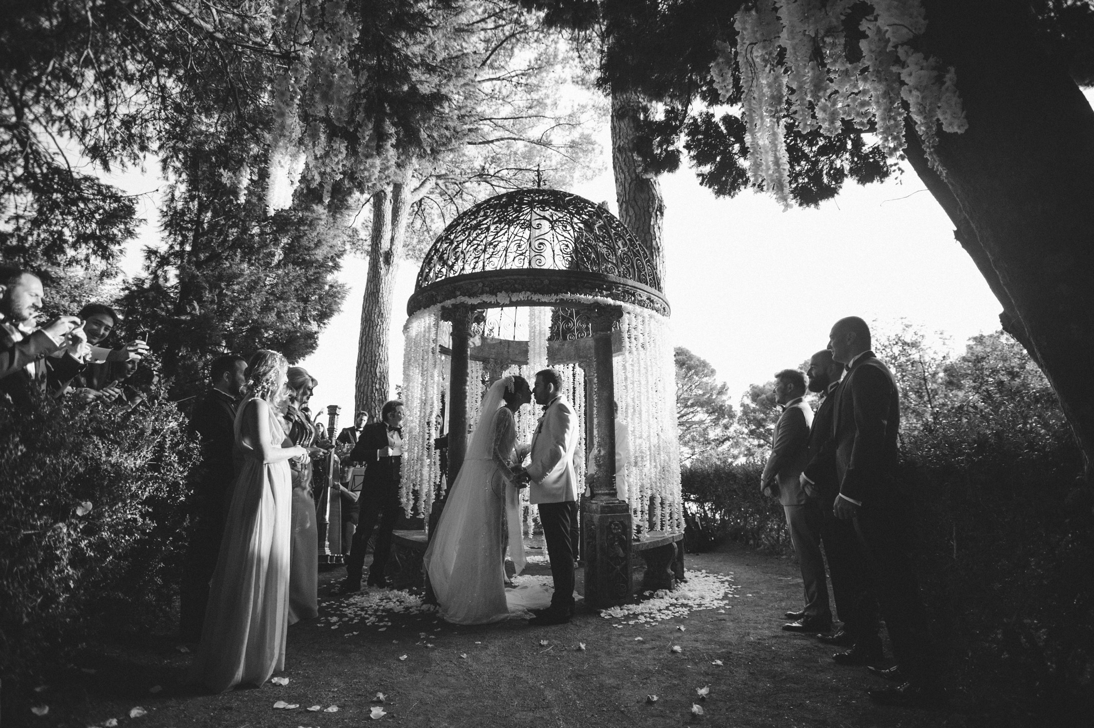 bride and groom kissing after the wedding vows black and white
