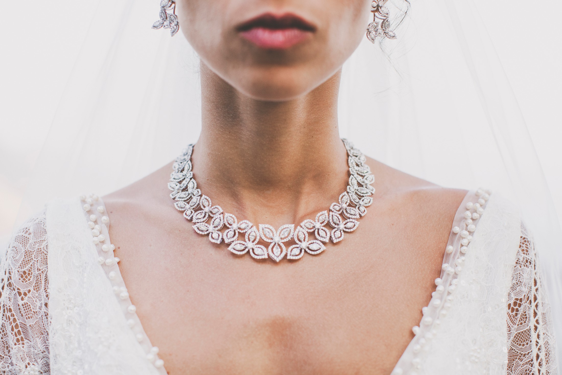 detail of the bride's wedding jewelry