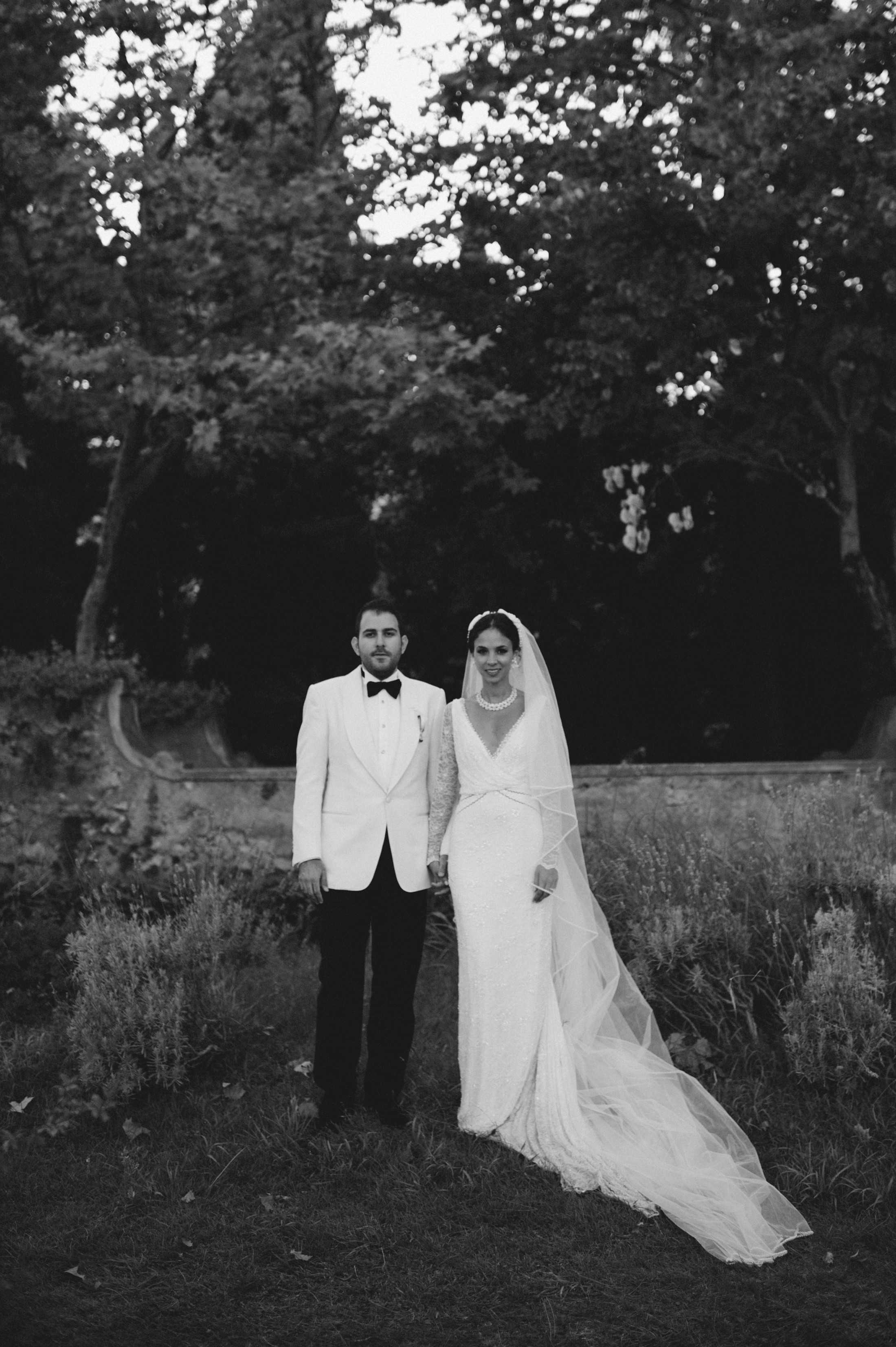 the bride and the groom standing black and white