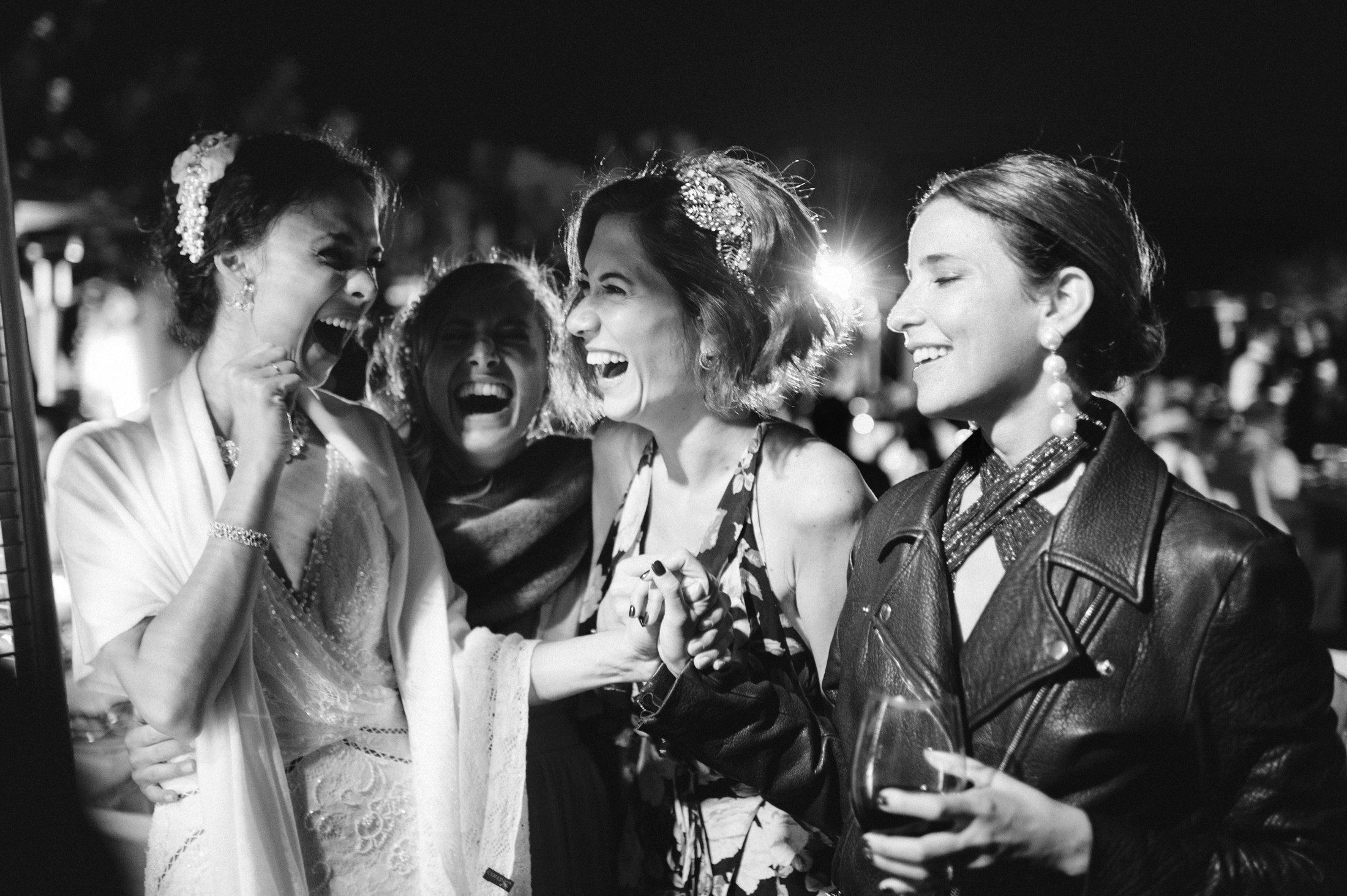 the bride laughing with some friends