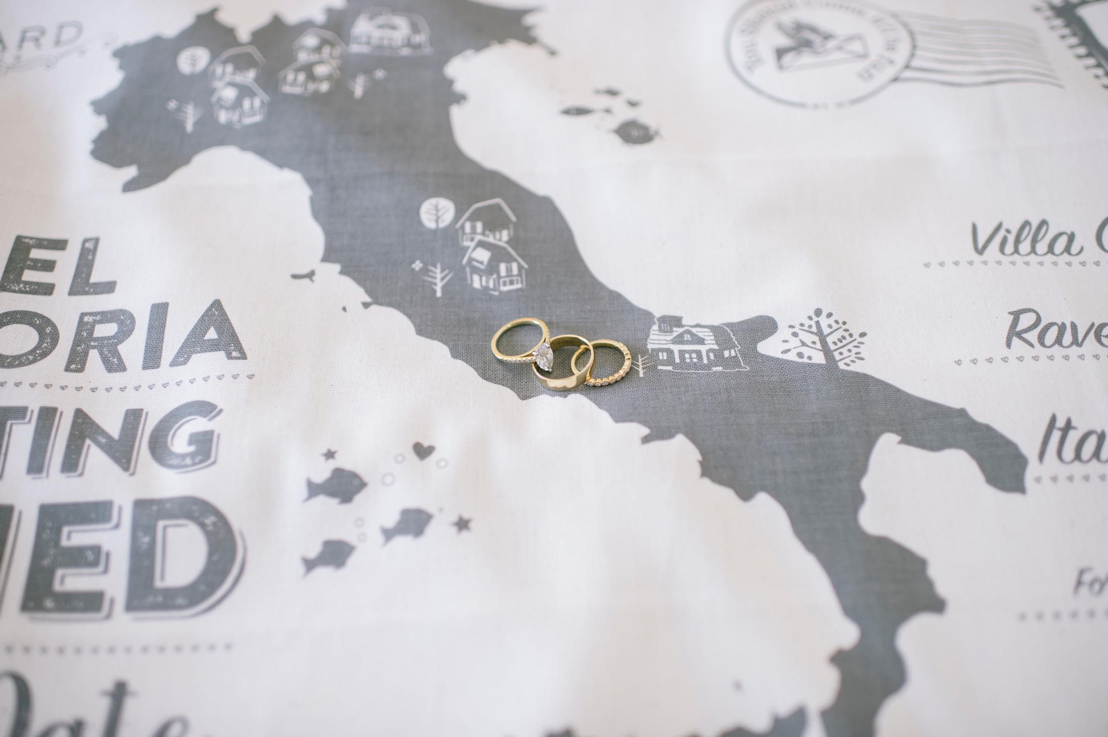wedding rings on a black and white map of Italy