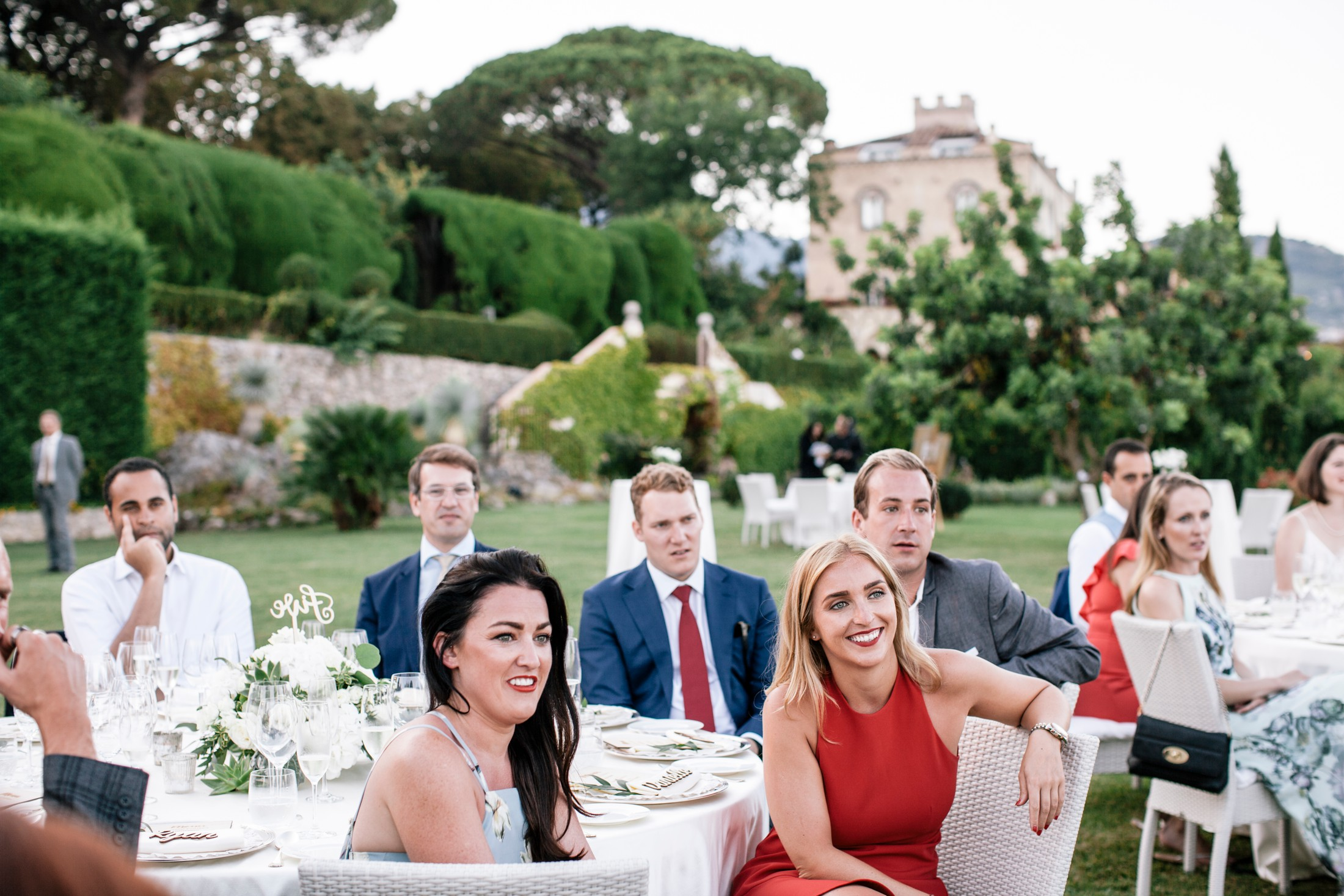 wedding guests at their table listening to the wedding speeches at villa cimbrone ravello