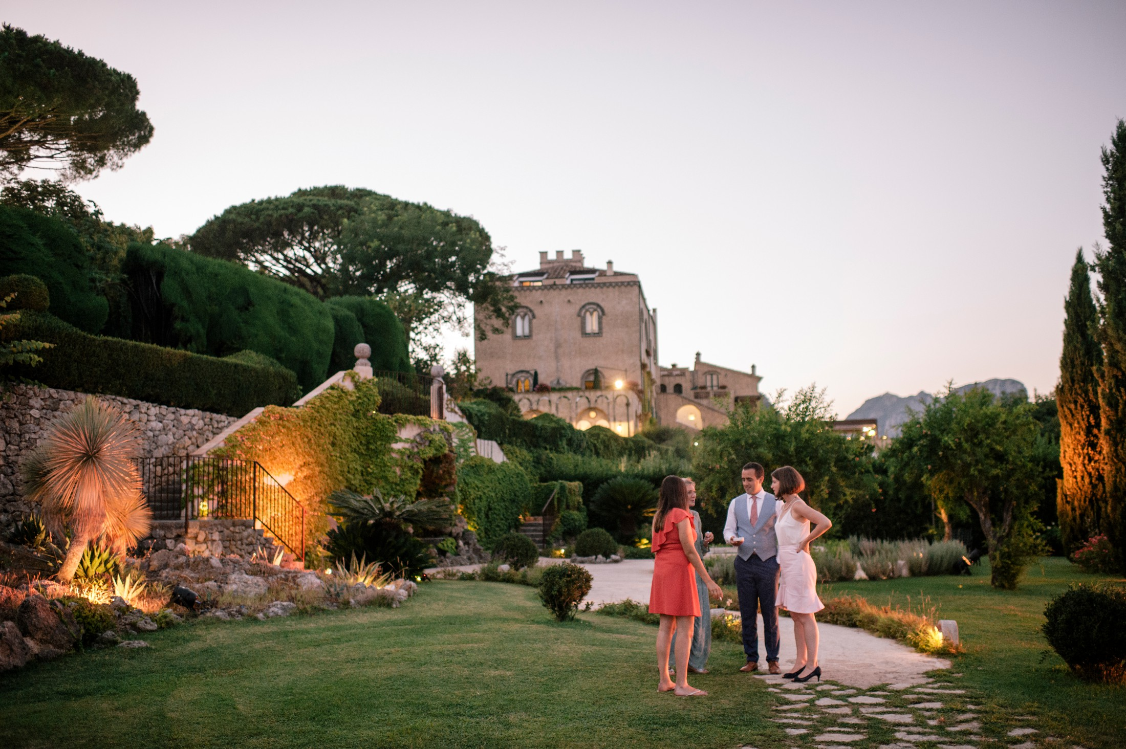 wedding guests talking together in villa cimbrone ravello