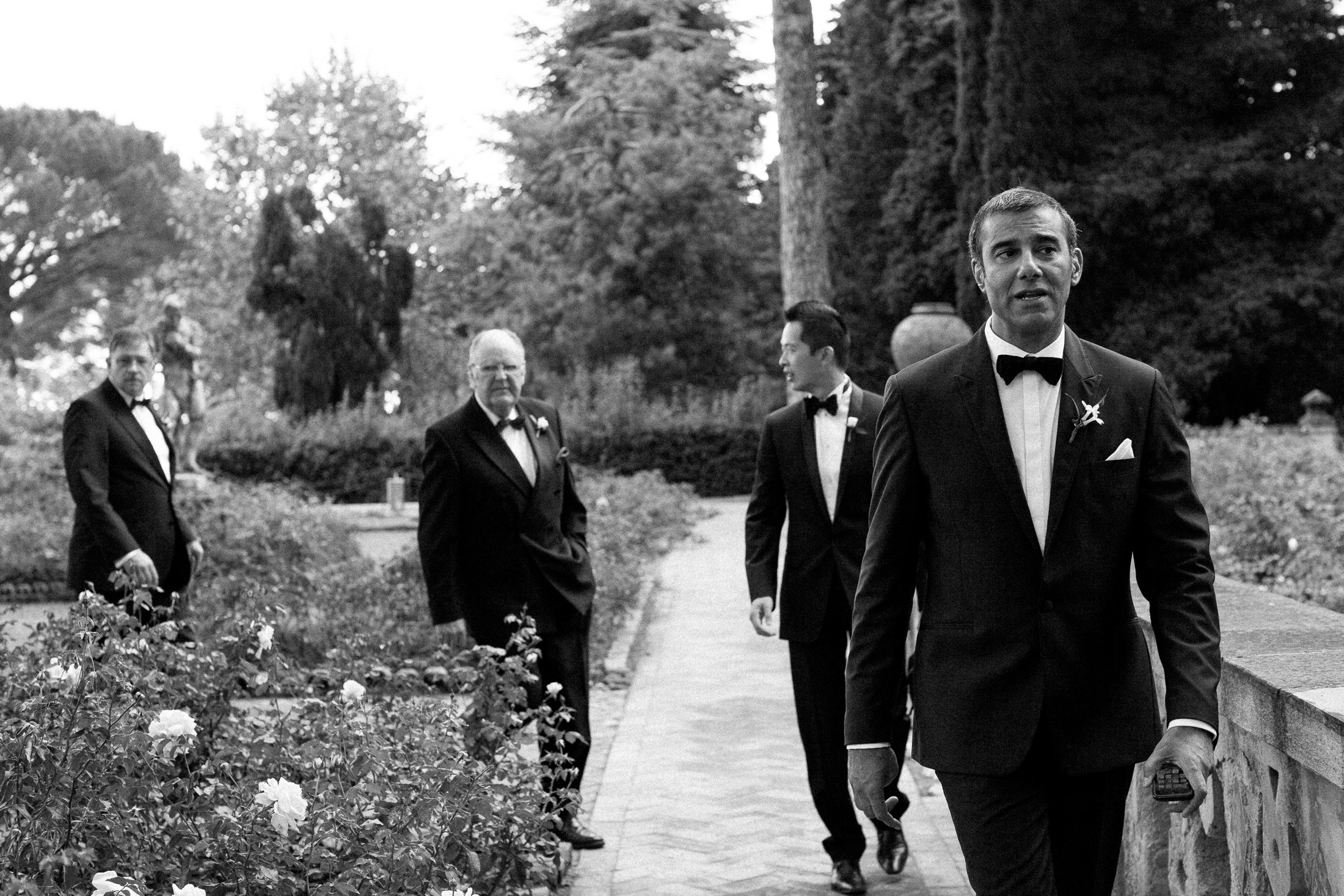the groom and some guest walk to the ceremony