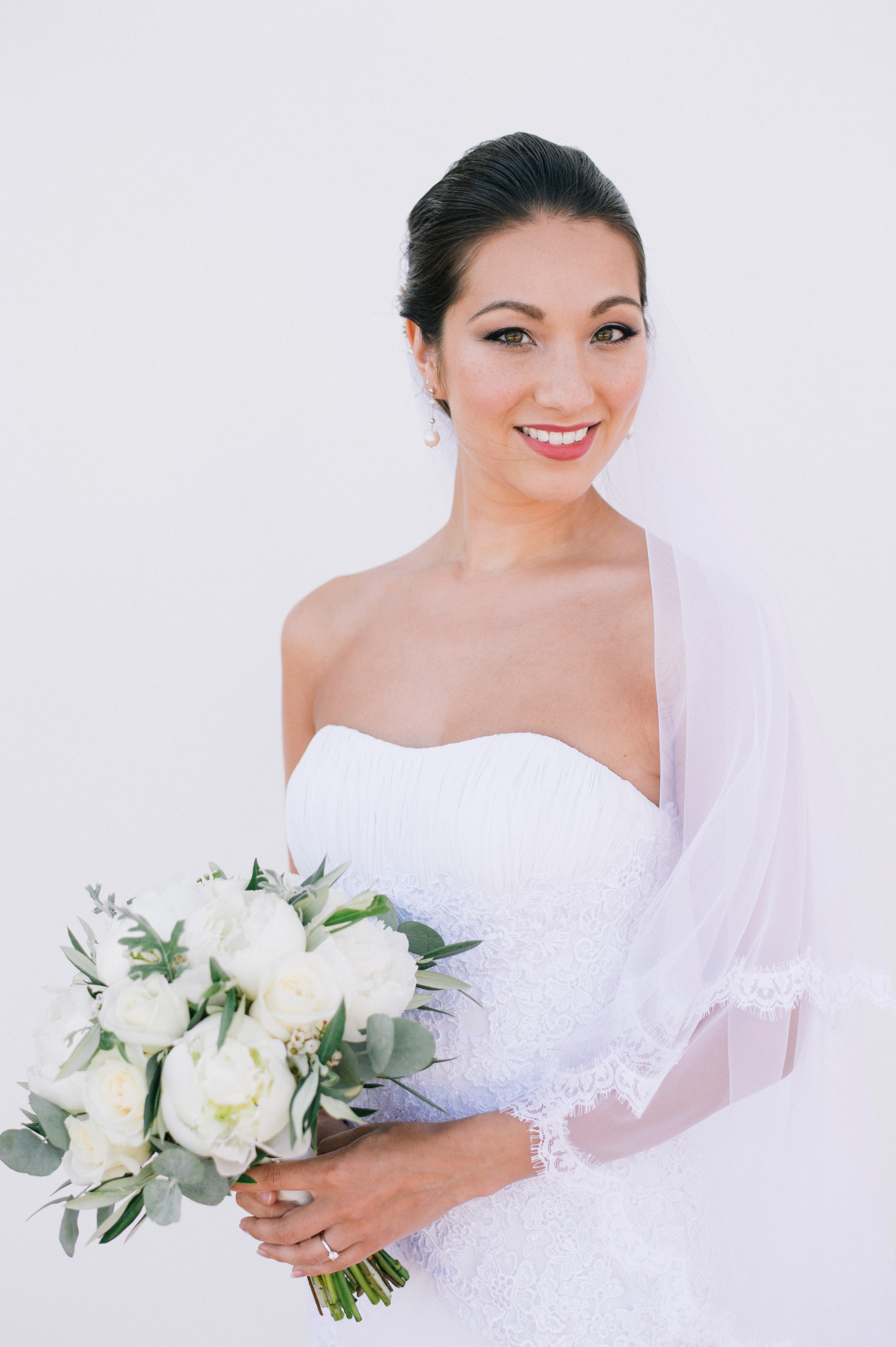 bride's portrait against a white wall