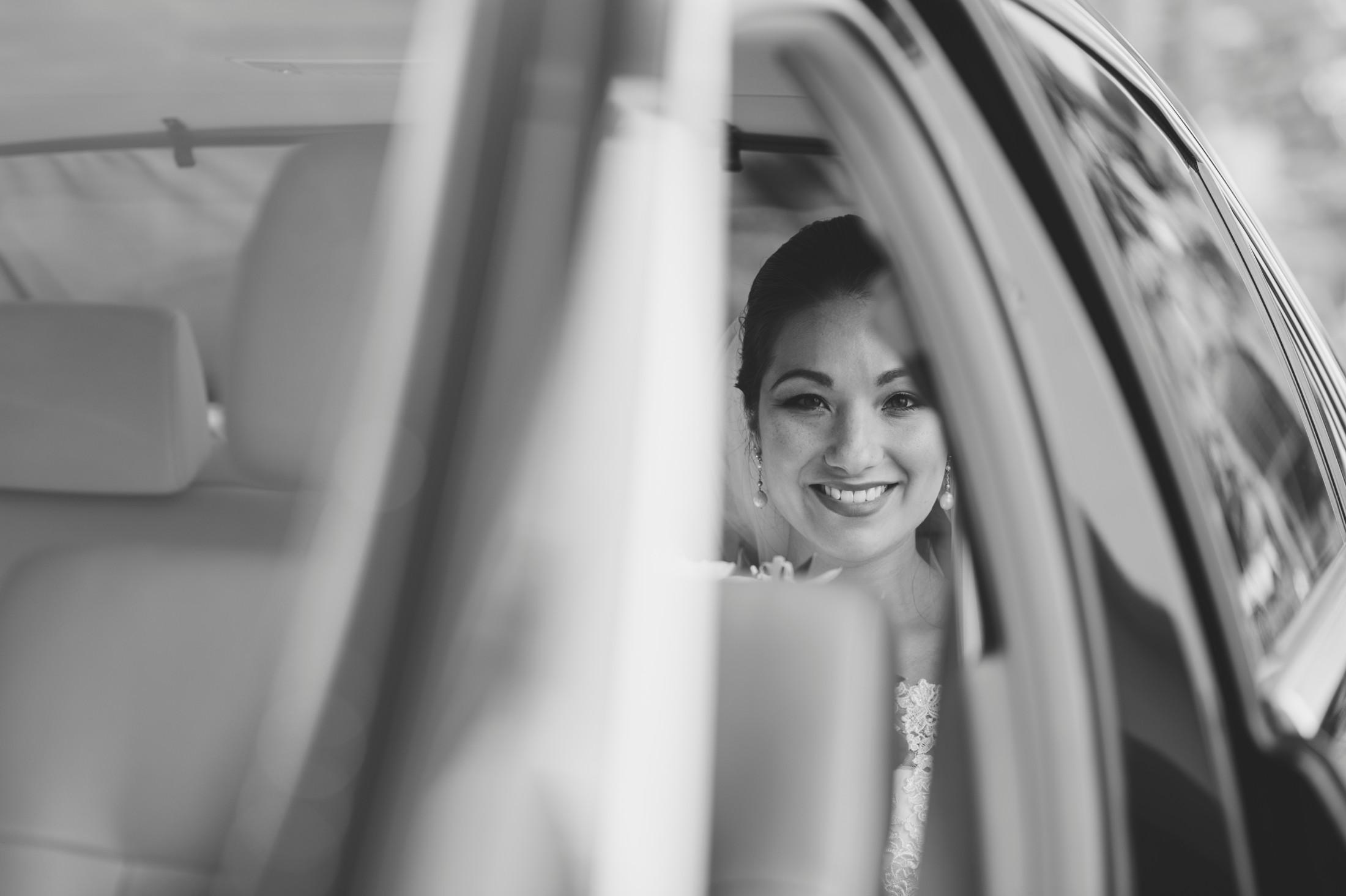 bride's portrait in the wedding car