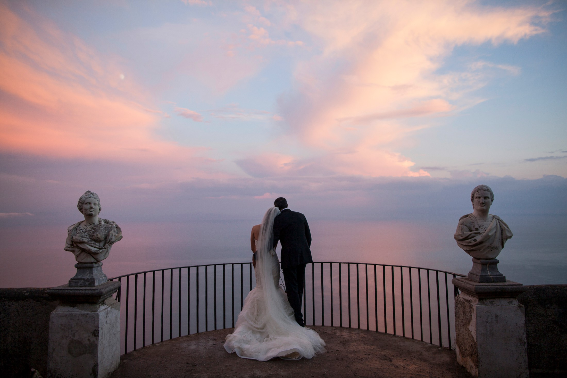 the bride and the groom on the infinity terrace at villa cimbrone on sunset time