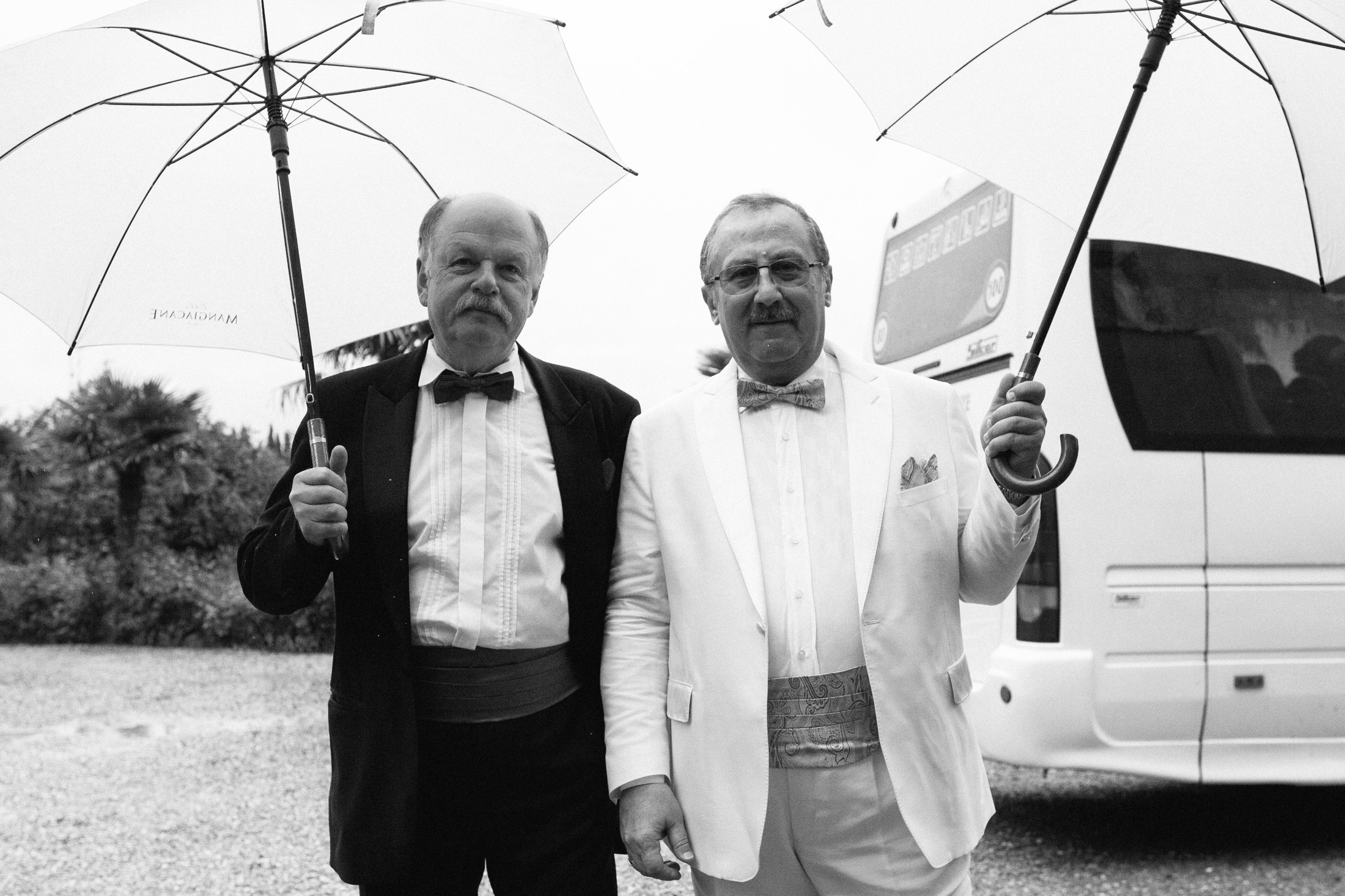 wedding guests with umbrella