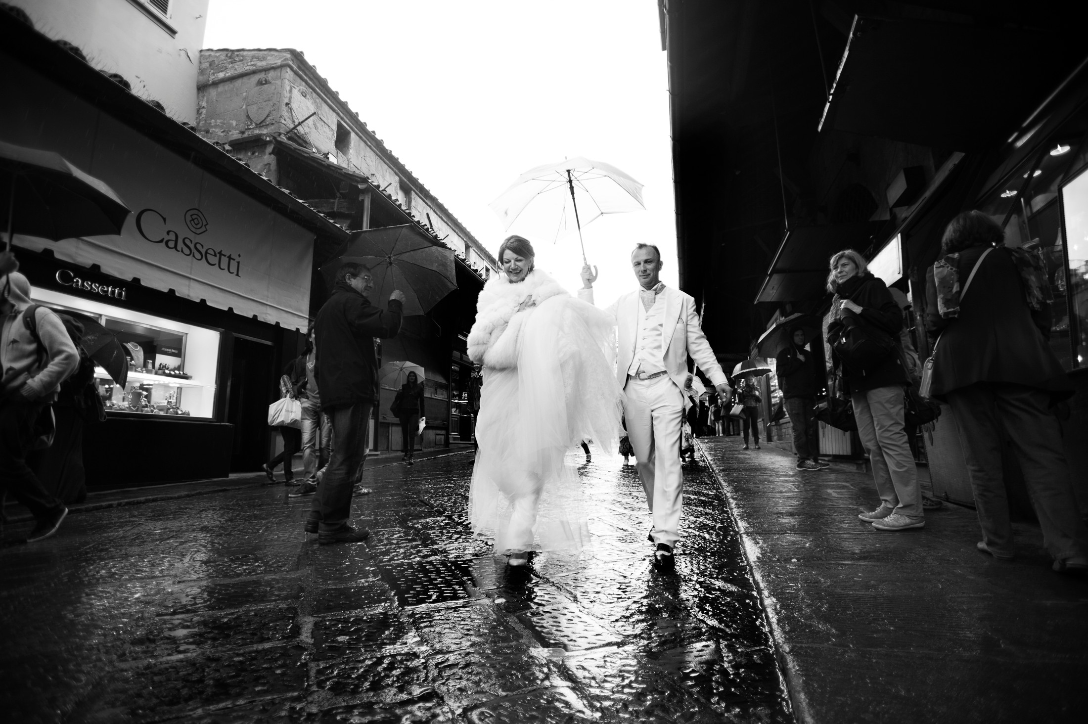the bride and the groom walking in Florence