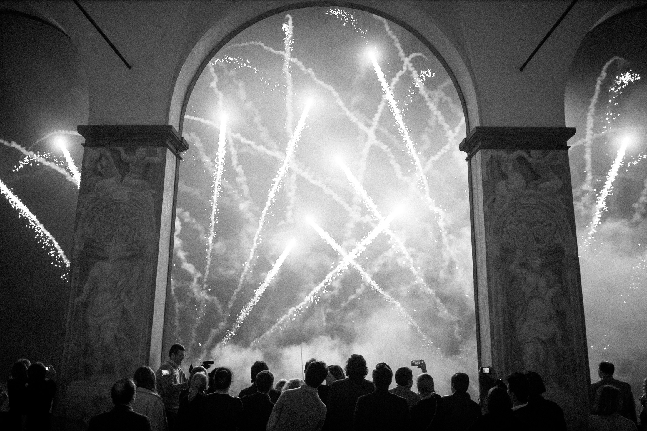 wedding guests looking at fireworks