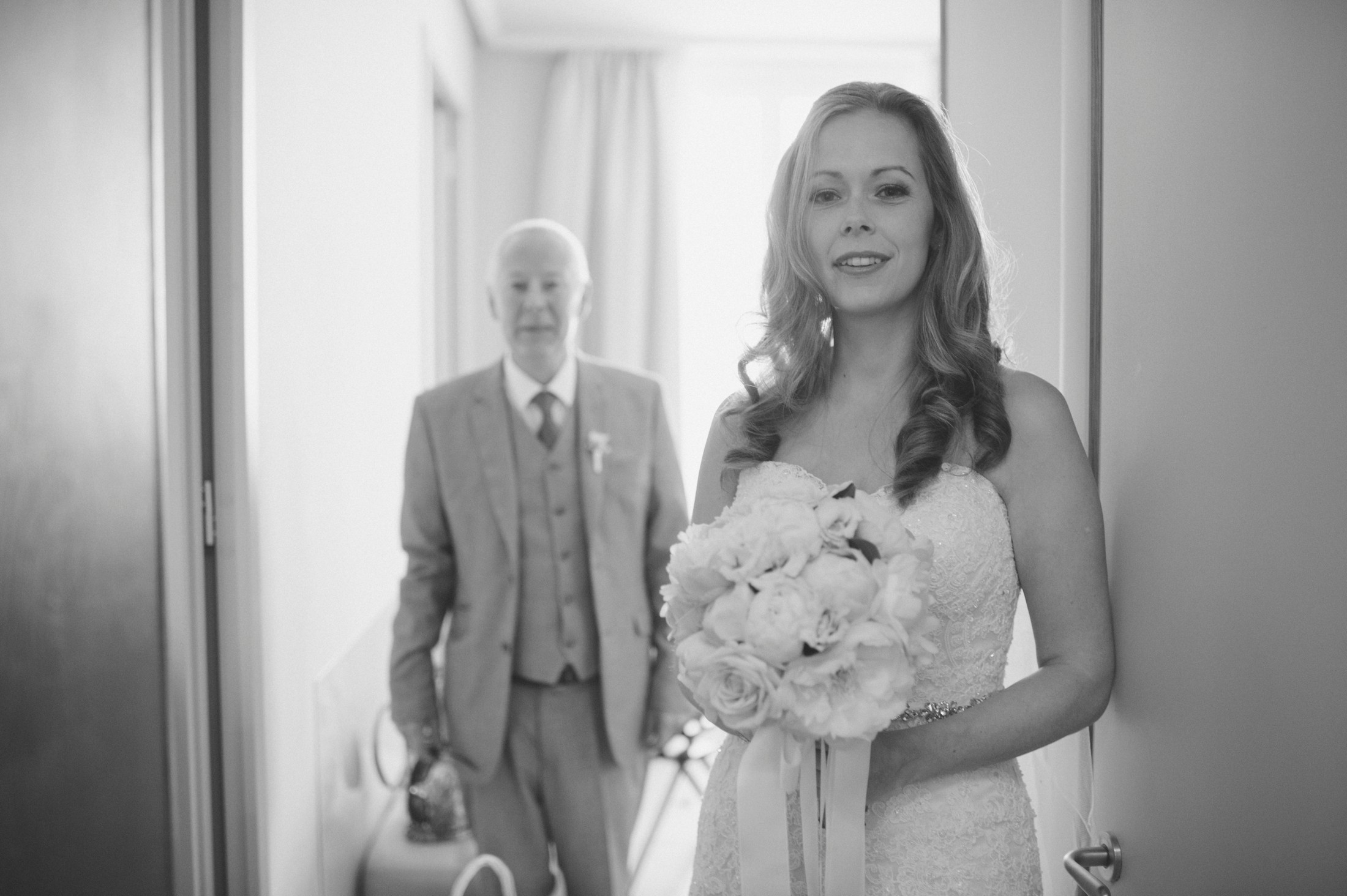 bride with her father in black and white