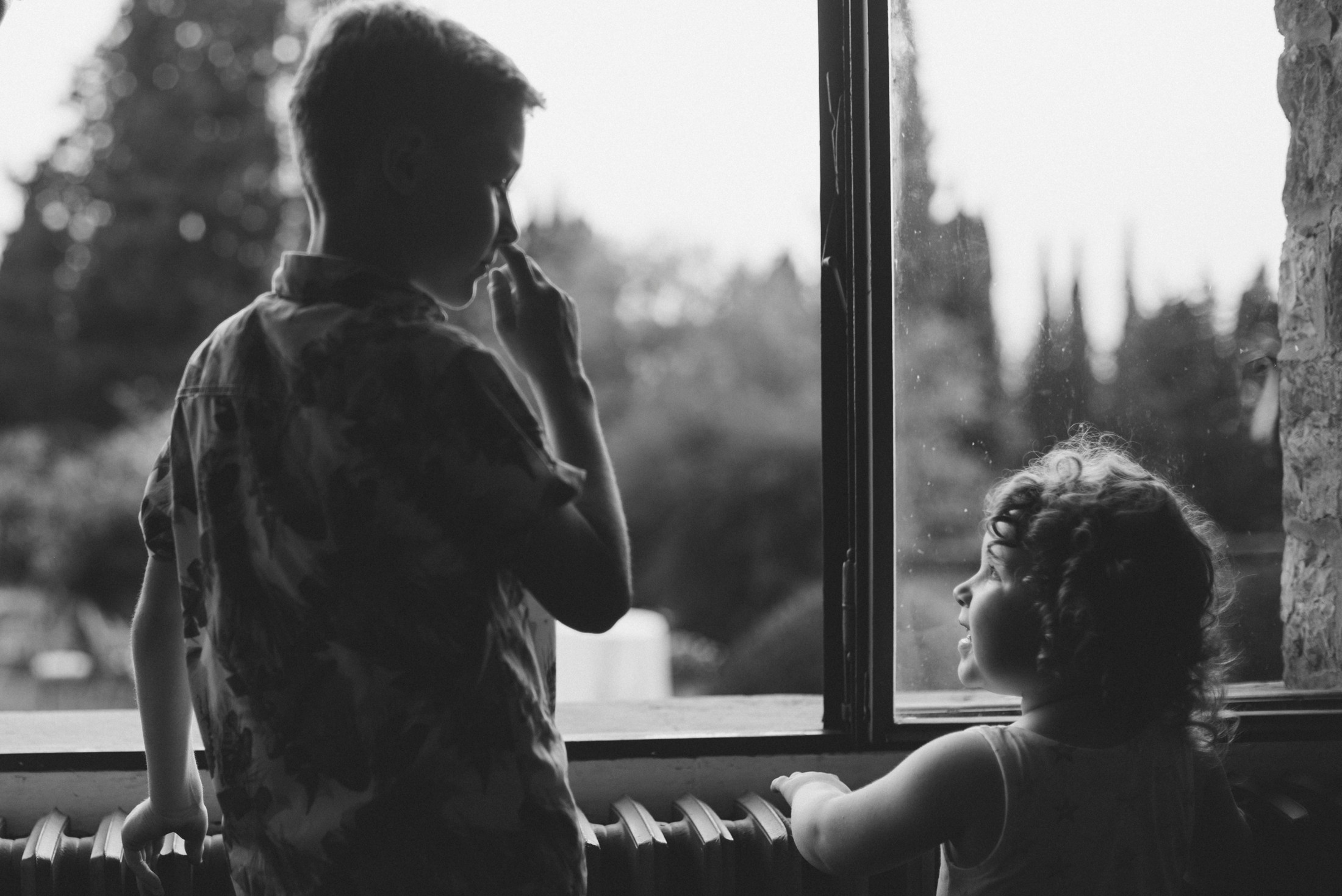 children talking at the window