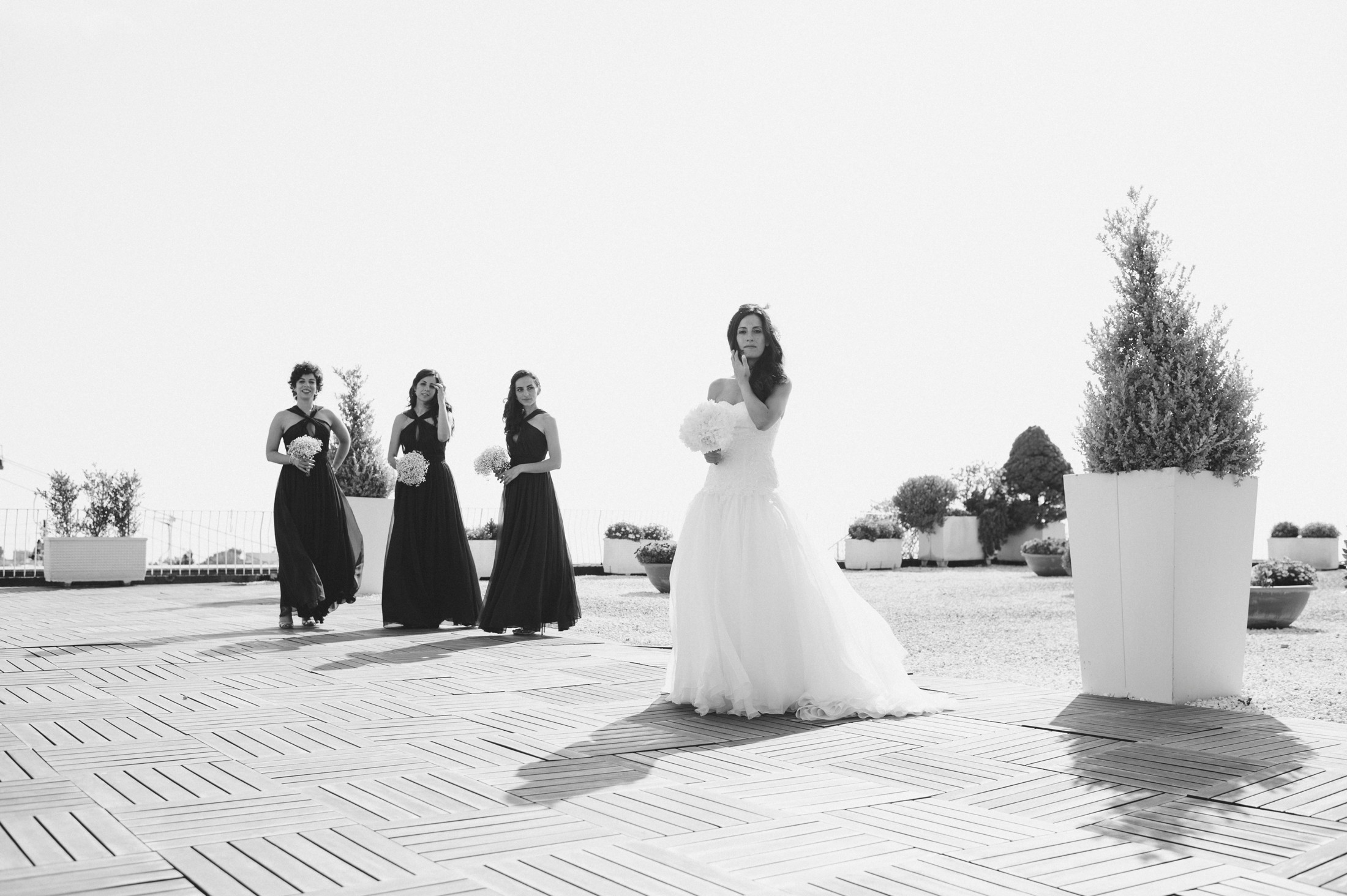the bride with her bridesmaids in black and white