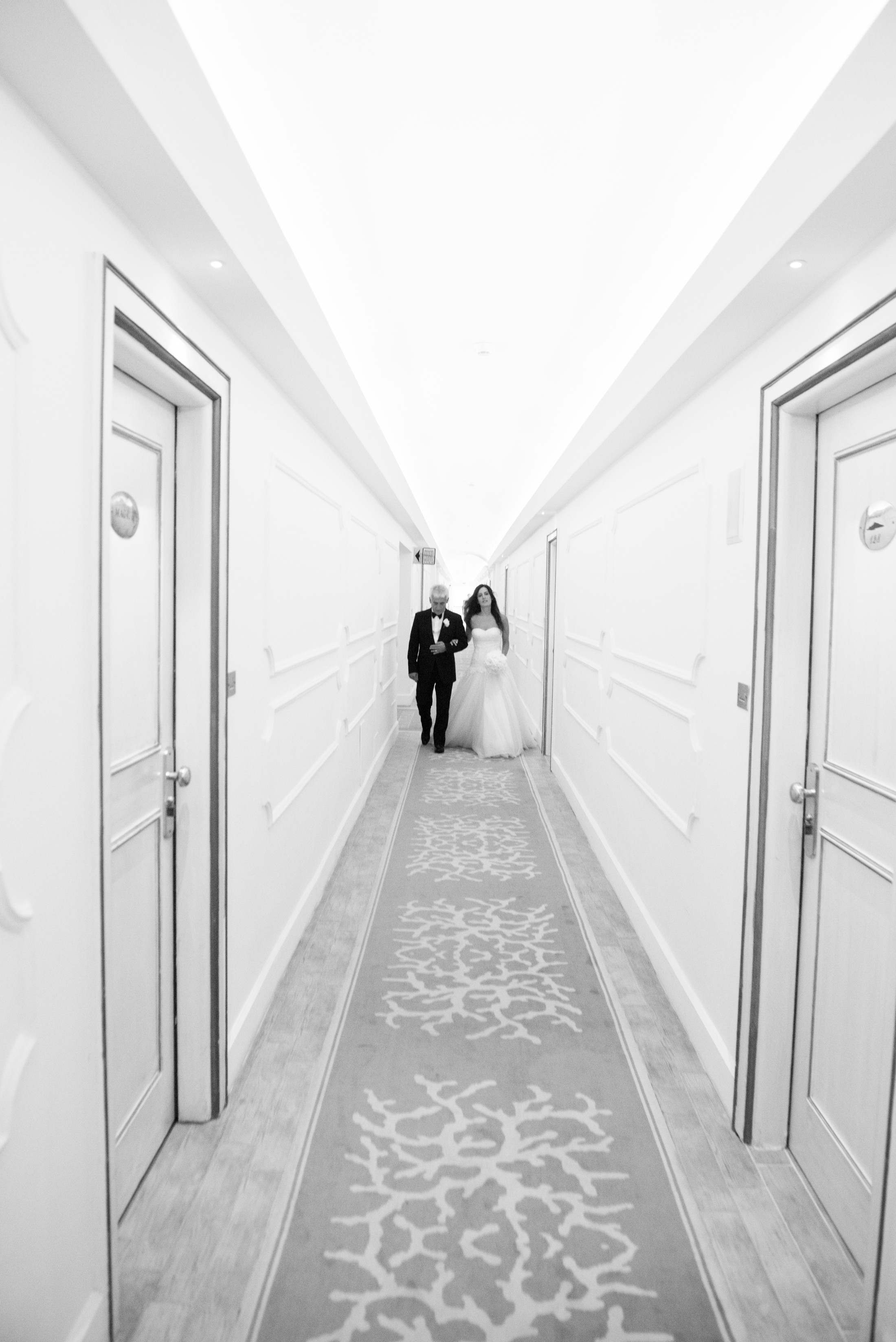 the bride leaves the hotel room with her father