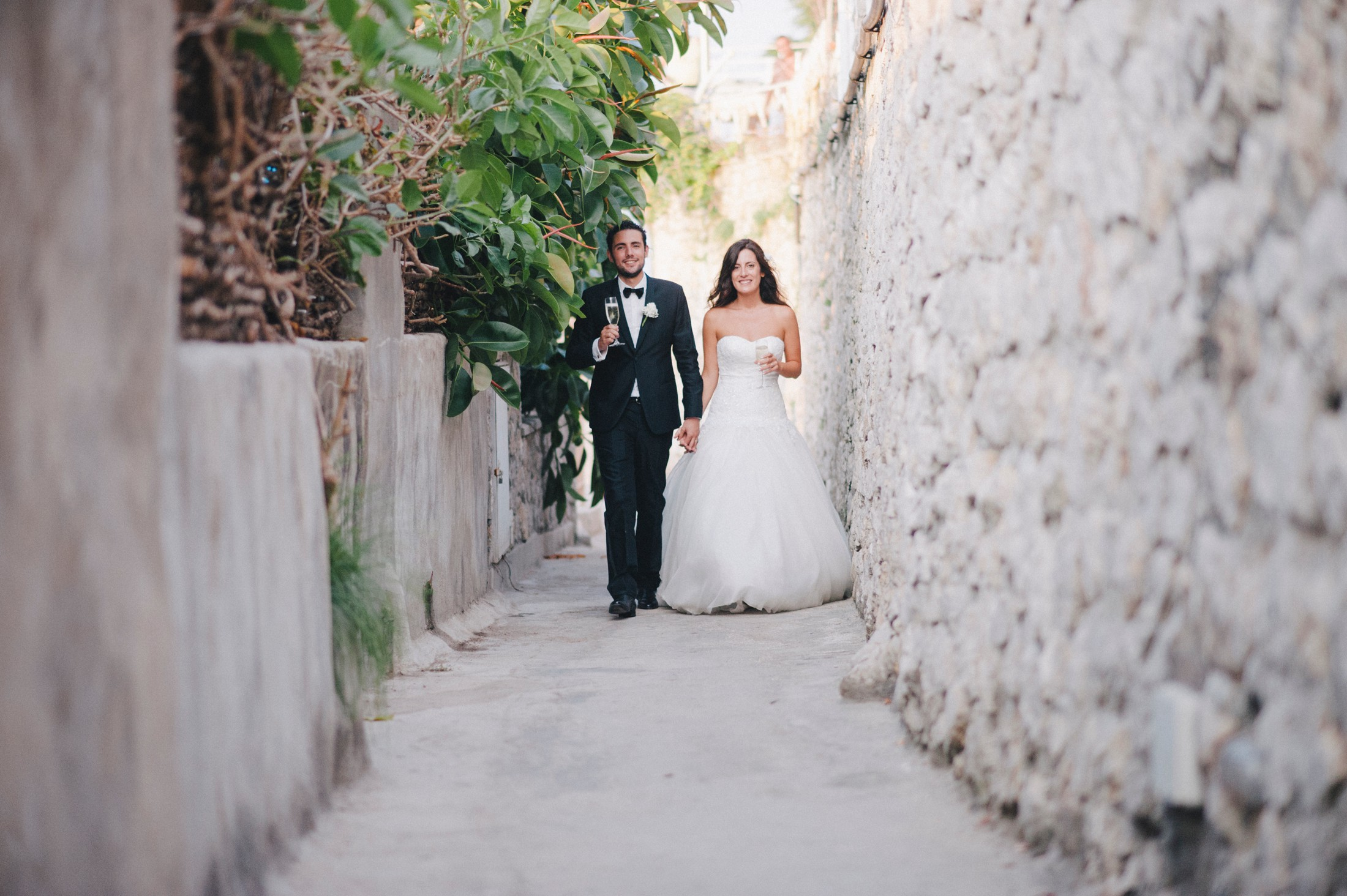 the bride and the groom walking together in capri