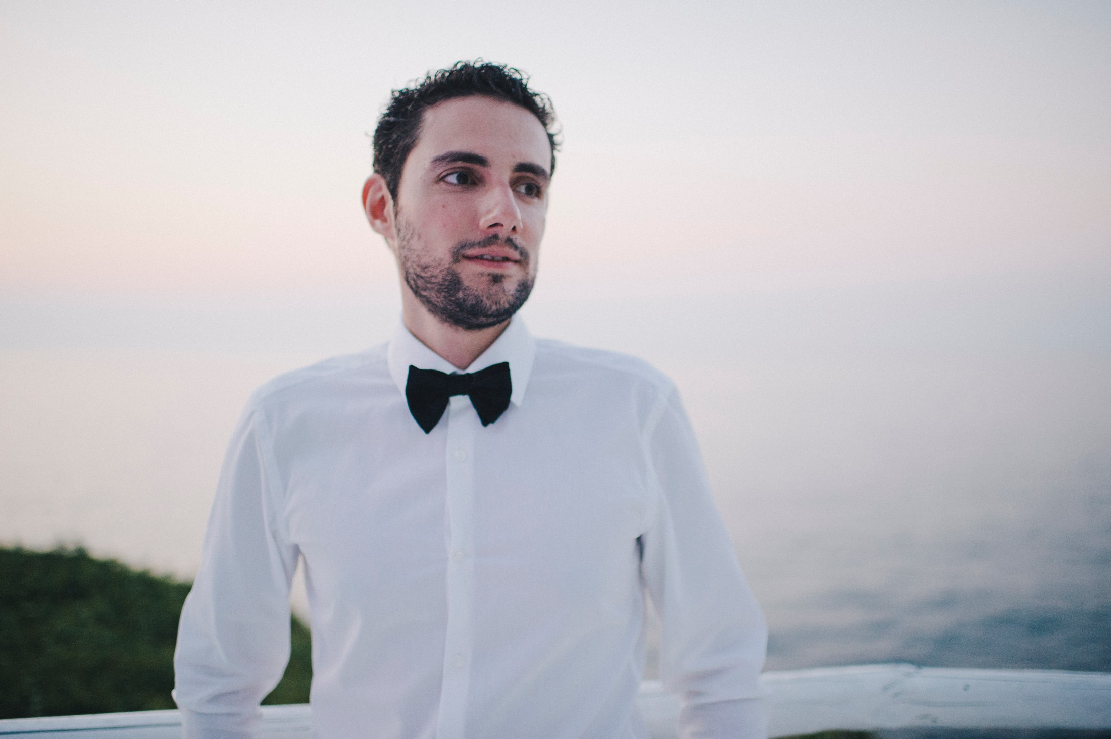 groom's portrait at sunset time