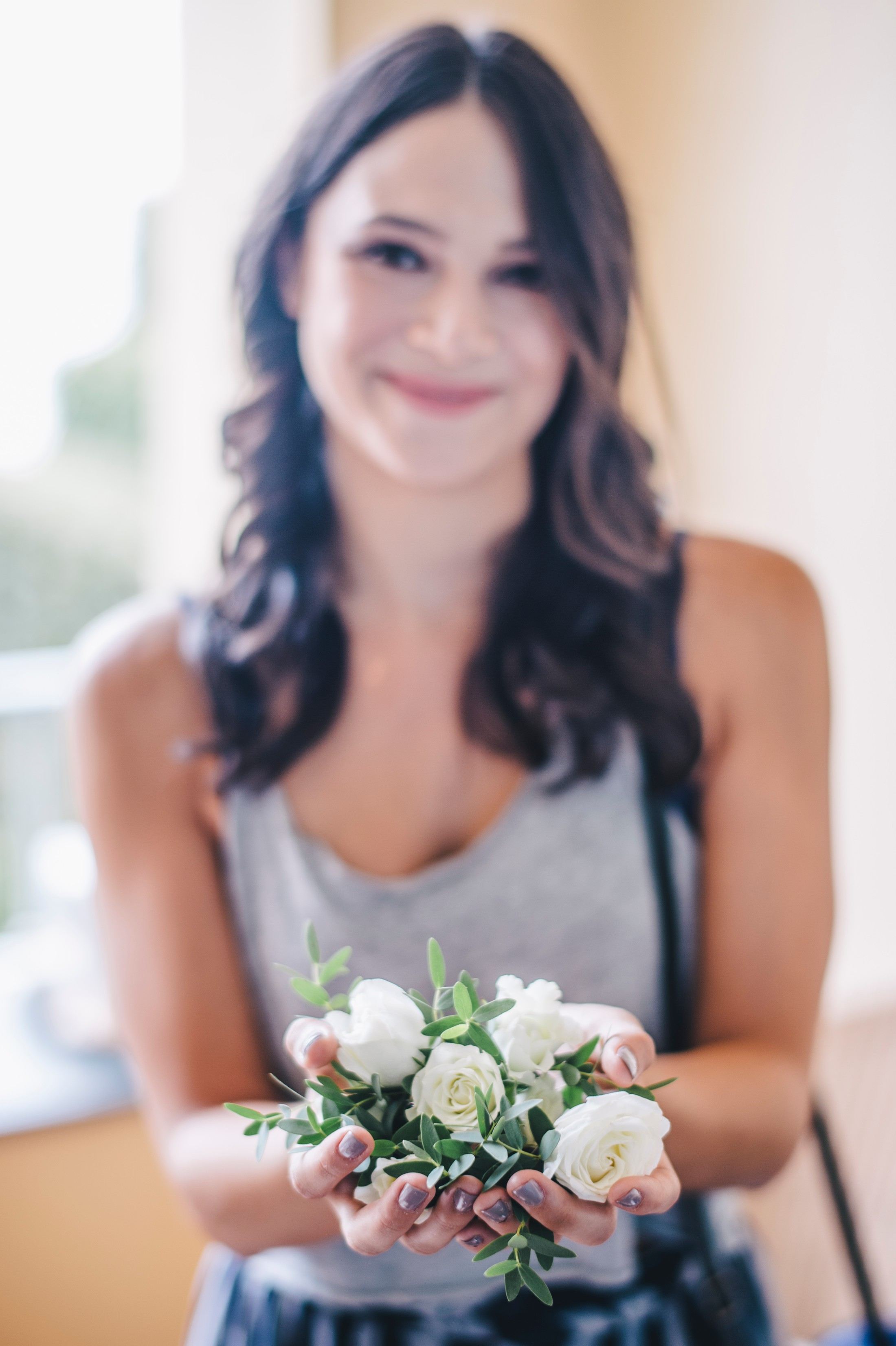 woman holds boutonniere